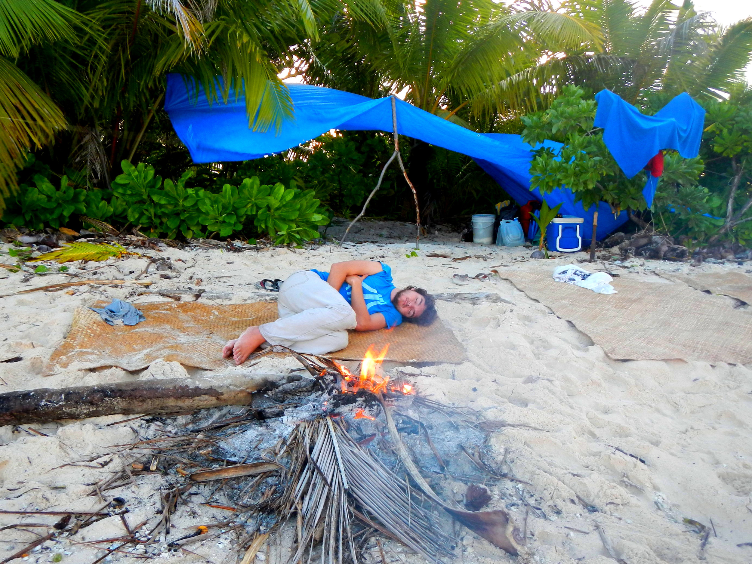 If the location and weather are good enough, wild camping might just be as simple as lying down! (Despite what my pose might suggest this was a very comfortable night sleeping on one of the  islets of Tuvalu )…