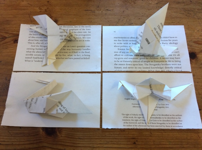 Interlope is a project which involves turning each of the  210 pages from Boris and Arkady Strugatski's Science fiction novel  'Roadside Picnic' in to an origami bird. An exercise in both digesting the text and origami incompetence. In the book, Red a 'Stalker' ventures illegally into a 'zone' to collect artefacts and debris left by an unknown ecological disaster or alien  visitation – the location is an undisclosed but is widely assumed to be  Russia. Parts of the narrative can be glimpsed on the folded sections of  the birds and the small square of paper left behind after making them.  this work develops ideas of language and silence, borders and boundaries  and the complicated systems of propaganda at work in creating fables  both in celebration of the soviet Empire and its demise. In 1979 Andrei tarkowski made a film called 'Stalker' based on the  narrative of 'Roadside Picnic' developing the concept of the 'Zone'. Tarkowsky was exiled by the Russian government due to the anti-soviet  sentiment expressed in his films ( the Zone widely thought to be a critique of the Gulags) and died not long later from a disease widely  attributed to the time spent shooting 'Stalker' on toxic wastelands.  This work begins to develop these narratives through the small gestures  of reading and paper folding, making reference to systems of  understanding and knowledge acquisition whilst using the emblem of the  bird as conduit.