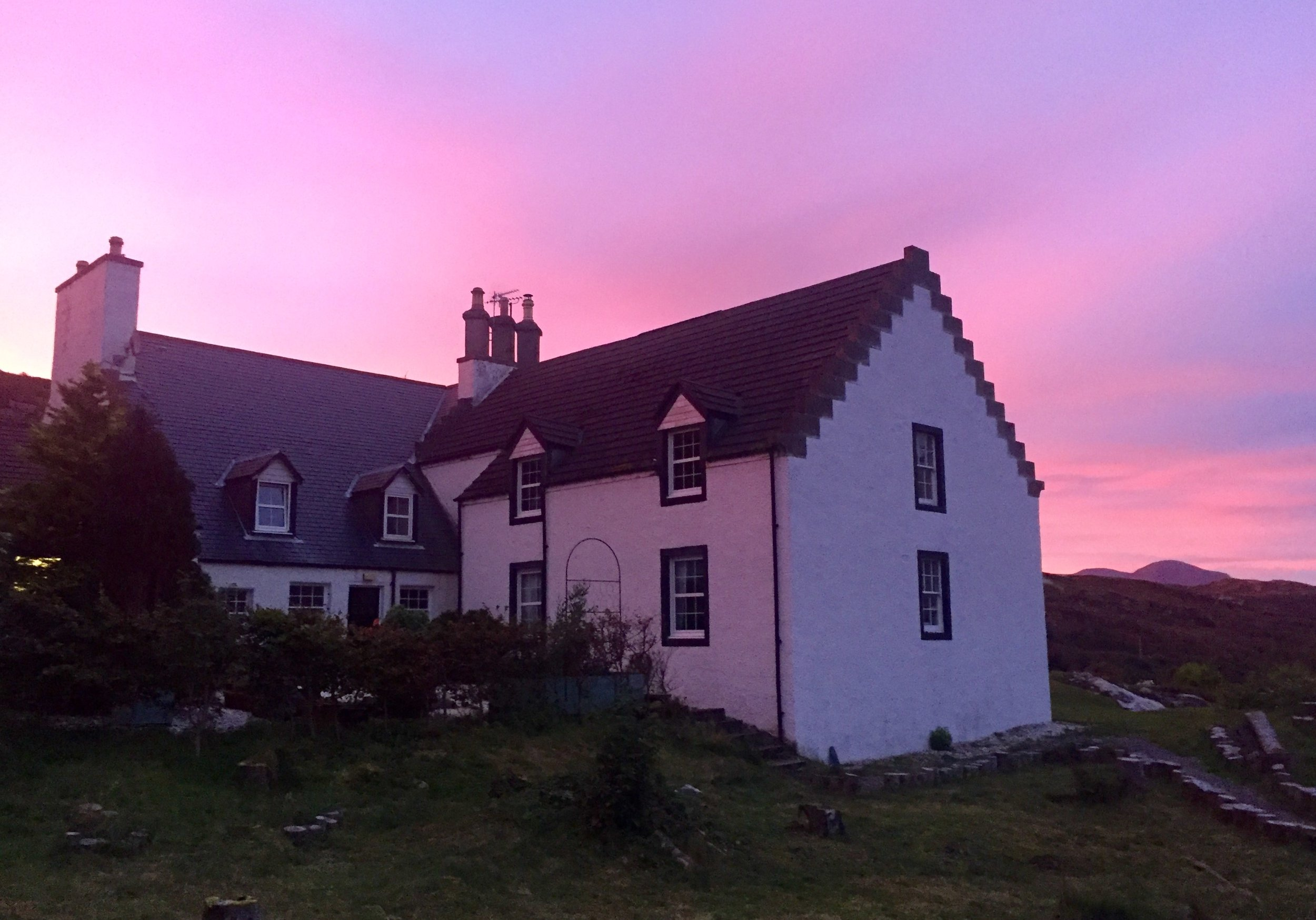 Autumn sunrise over Eddrachilles Hotel. Showing the service area of the original manse (today's dining room) and to the right the new hotel bedrooms in a separate wing