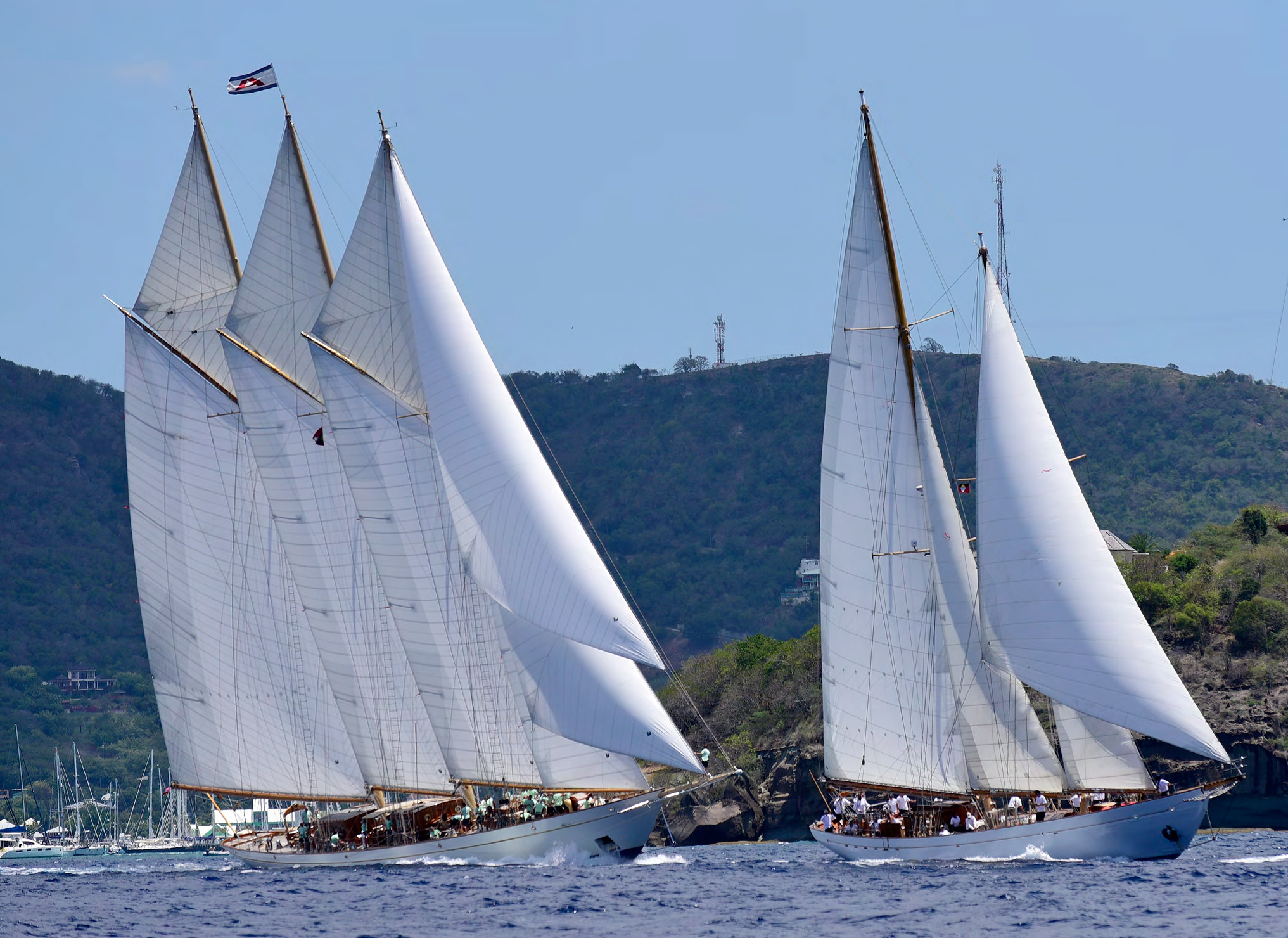 Eros enjoys a thrilling start with 200 ft. three-masted schooner Adix at the Antigua Classic Regatta. Photos by Mark Krasnow.