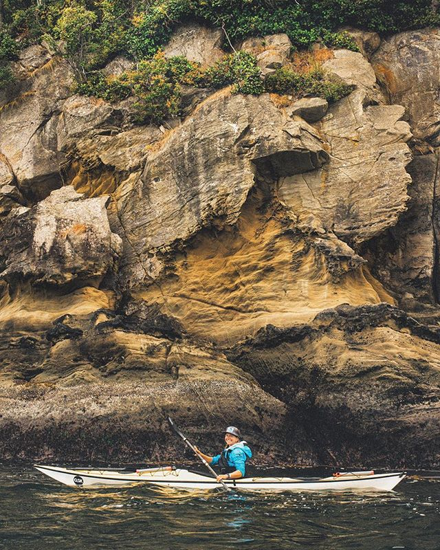 Our badass guide @heapmonster of @outdoorodysseys showing us the sea cliffs lost among the San Juan's of Washington. - * - #rei1440project #seakayaking #camp #campingvibes #kayaking #outdoorodyssey #sanjuanislands #orcasisland #openocean #seacliffs #travelwashington #explorewashington #paddle #paddler  #juandefuca #washingtonstate #liked #followmeto