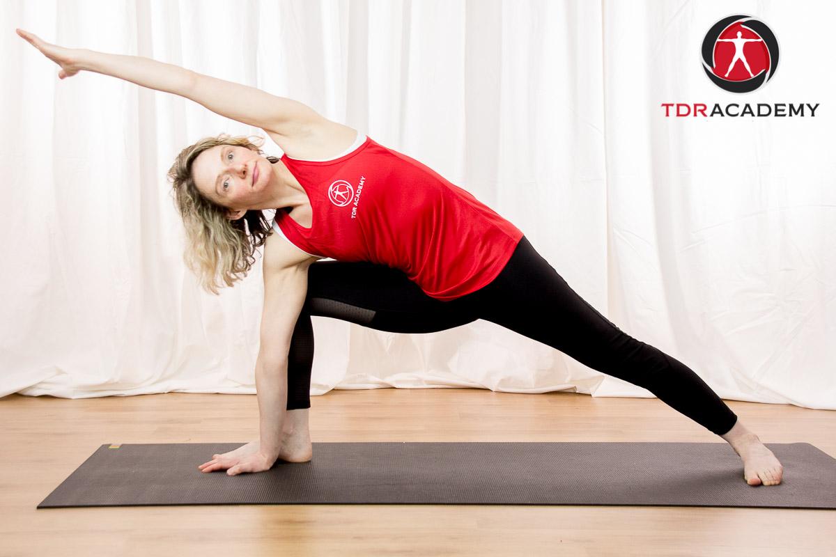 Feb 2018 TDR Tanya side angle yoga with logo.jpg
