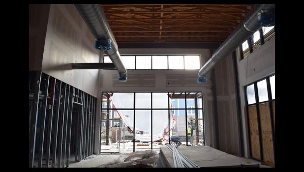 """According to founder of Bin 526 Mike White, the new Starbucks location on Daniel Island will feel like a """"cathedral of coffee"""" with 30-foot ceilings and plenty of seating, both inside and out."""