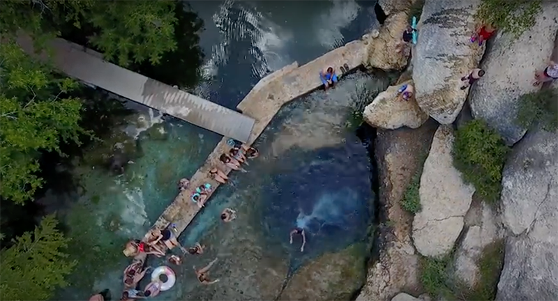 Jacob's Well, an artesian spring a few miles north of Wimberley, isn't your average dip in the pool. The crystal-clear water of this popular swimming hole has been drawing Central Texans for at least 150 years.