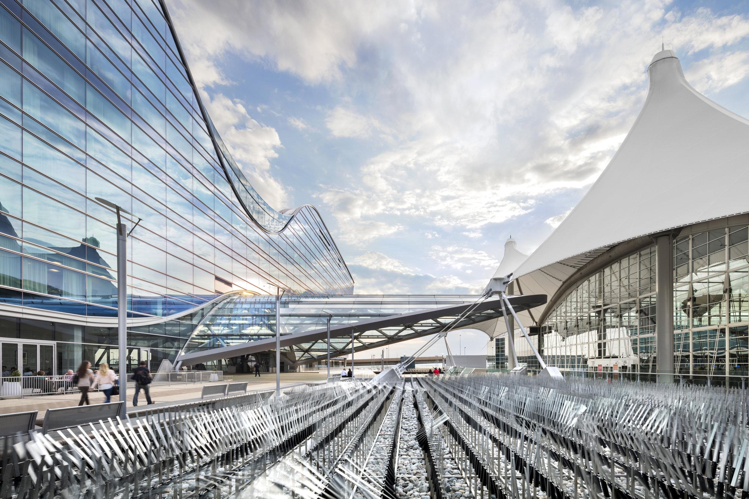 "<img src="" studioINSITE_WestinDEN_Plaza_Artistic Element ""alt=""Denver International Airport, DIA, Denver, CO, Colorado, Airport, Art, Hotel, Transit, Light Rail, Events, Arts, Sculpture, Plaza, Transportation, Terminal, Hub  ""title=""Denver International Airport - Westin Hotel Plaza  ""/>"