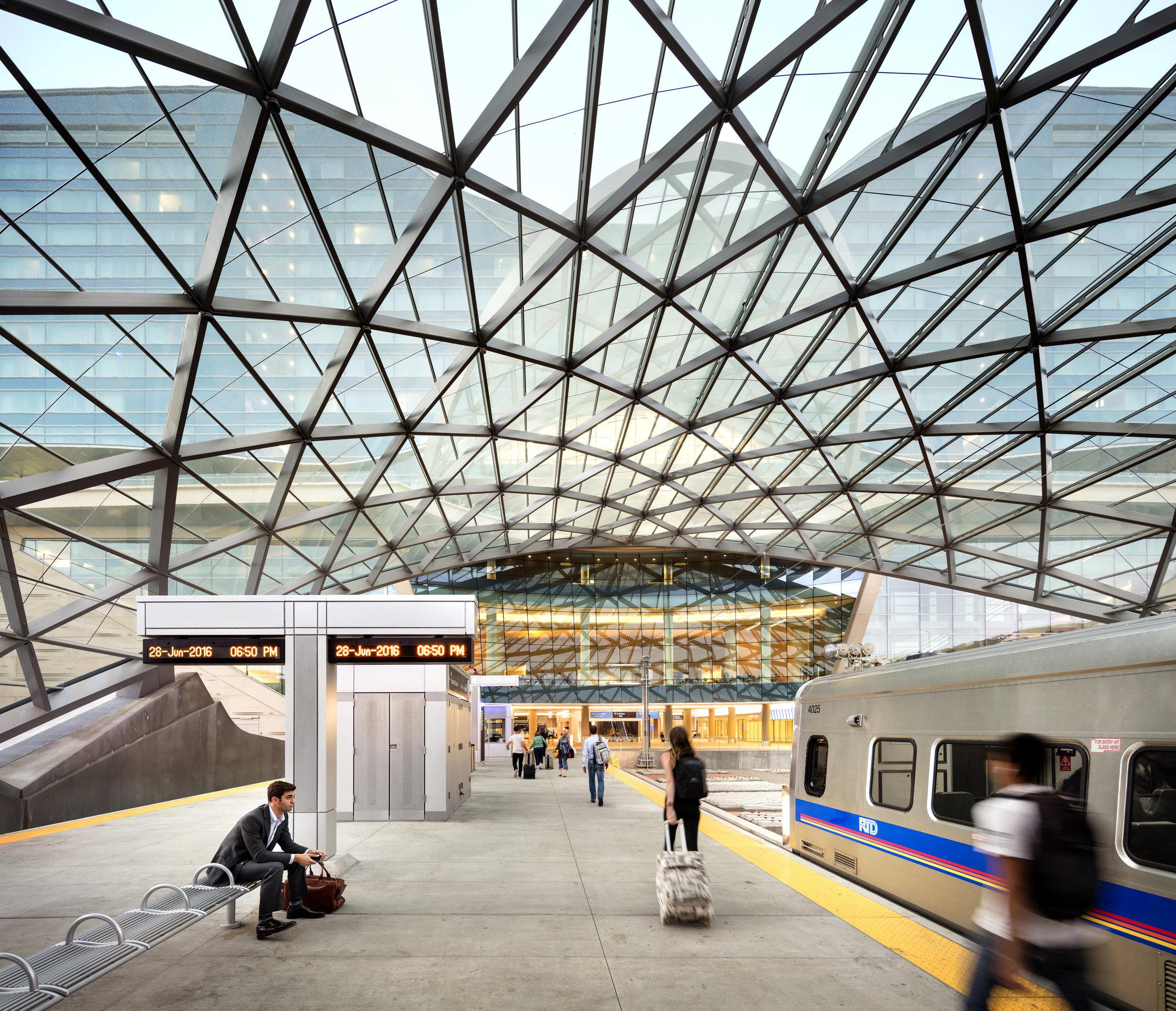 "<img src="" studioINSITE__WestinDEN_Train Terminal ""alt=""Denver International Airport, DIA, Denver, CO, Colorado, Airport, Art, Hotel, Transit, Light Rail, Events, Arts, Sculpture, Plaza, Transportation, Terminal, Hub  ""title=""Denver International Airport - Westin Hotel Plaza  ""/>"