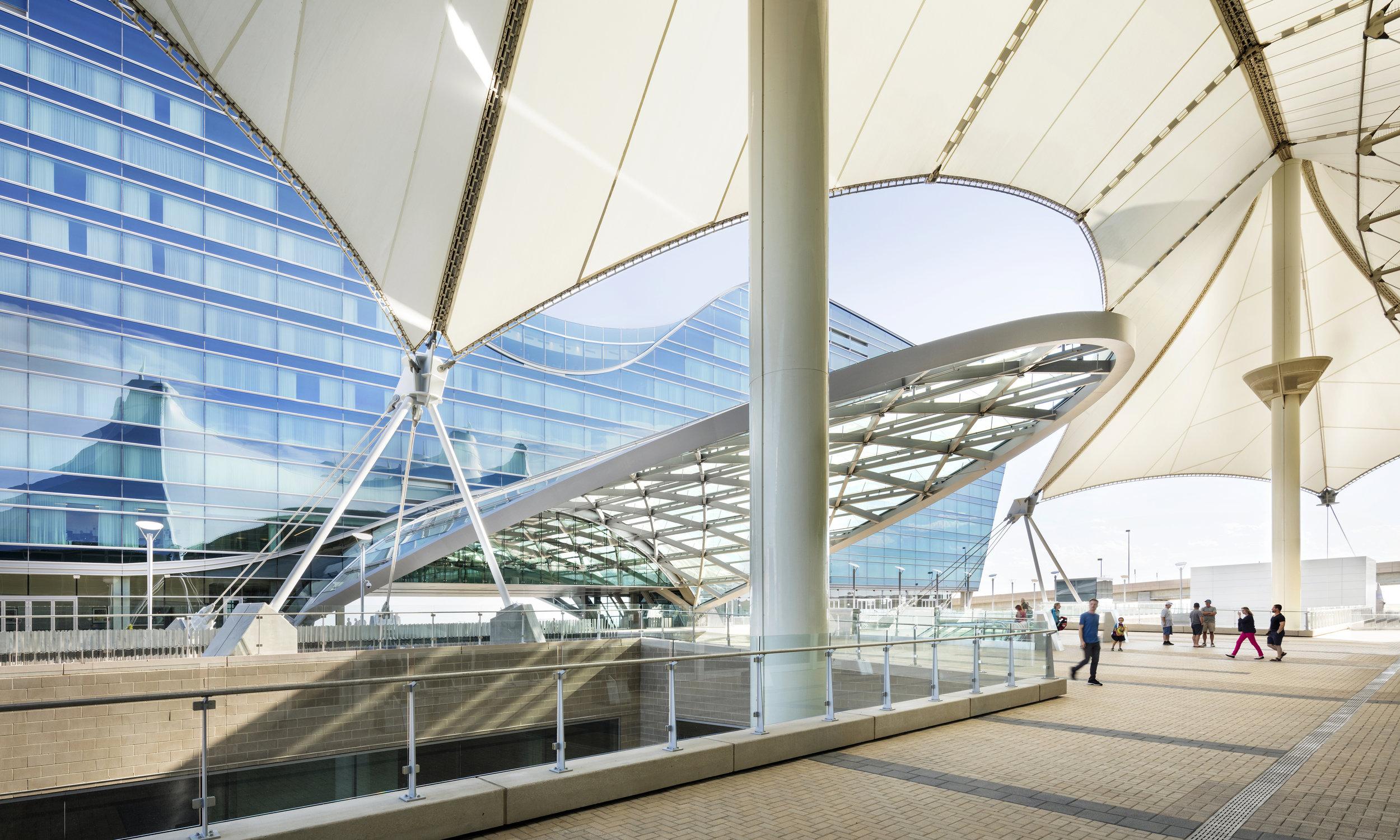 "<img src="" studioINSITE_WestinDEN_Plaza_Architecture2 ""alt=""Denver International Airport, DIA, Denver, CO, Colorado, Airport, Art, Hotel, Transit, Light Rail, Events, Arts, Sculpture, Plaza, Transportation, Terminal, Hub  ""title=""Denver International Airport - Westin Hotel Plaza  ""/>"