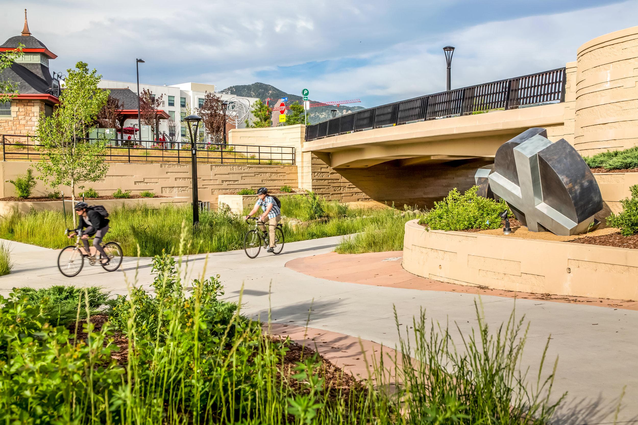 """<img src="""" studioINSITE_Boulder_Junction_Place_Greenway_2 bikers """"alt=""""Boulder, Junction Place, Bike Trails, Transite Depot, Bridge, Streetscape, Greenway, Landscape Art, Art, Public Outreach, Landscape Architecture, Urban Design  title=""""Boulder Junction Place  """"/>"""