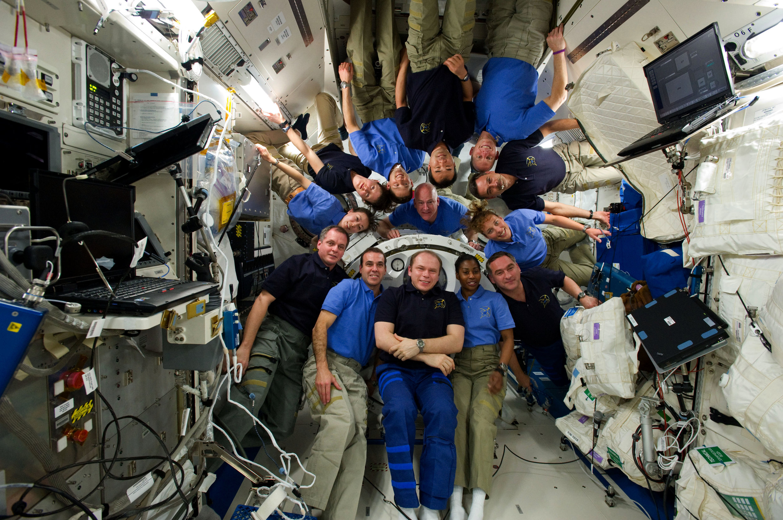 Seven astronauts from Space Shuttle Endeavor (in blue shirts) join the ISS crew for a group portrait in the Japanese module Kibo. It was the first time four women were in orbit together. Photo credit: NASA