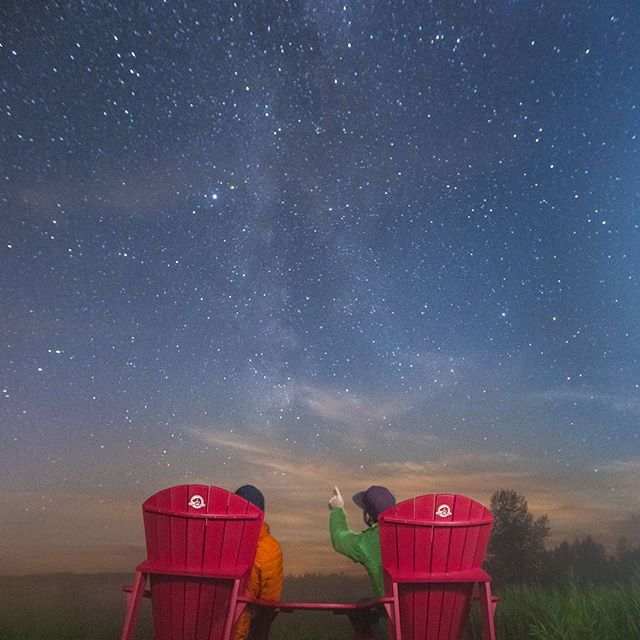 There's nothing better than a Muskoka chair (or Adirondack if you like) and gazing into the night sky. Especially since there's 7 new planets out there! . . . ©Parks Canada  Photo by Ryan Bray #darksky #redchairs #parkscanada #explorealberta #wanderlustalberta