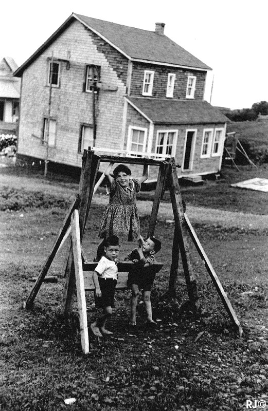 Three kids on swing - Gaspé, 1954
