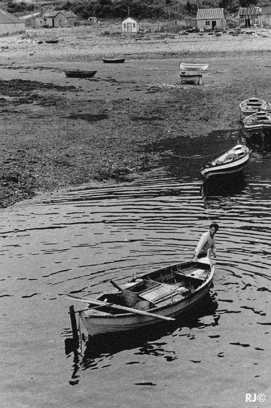 Man with boat - Gaspé, 1954