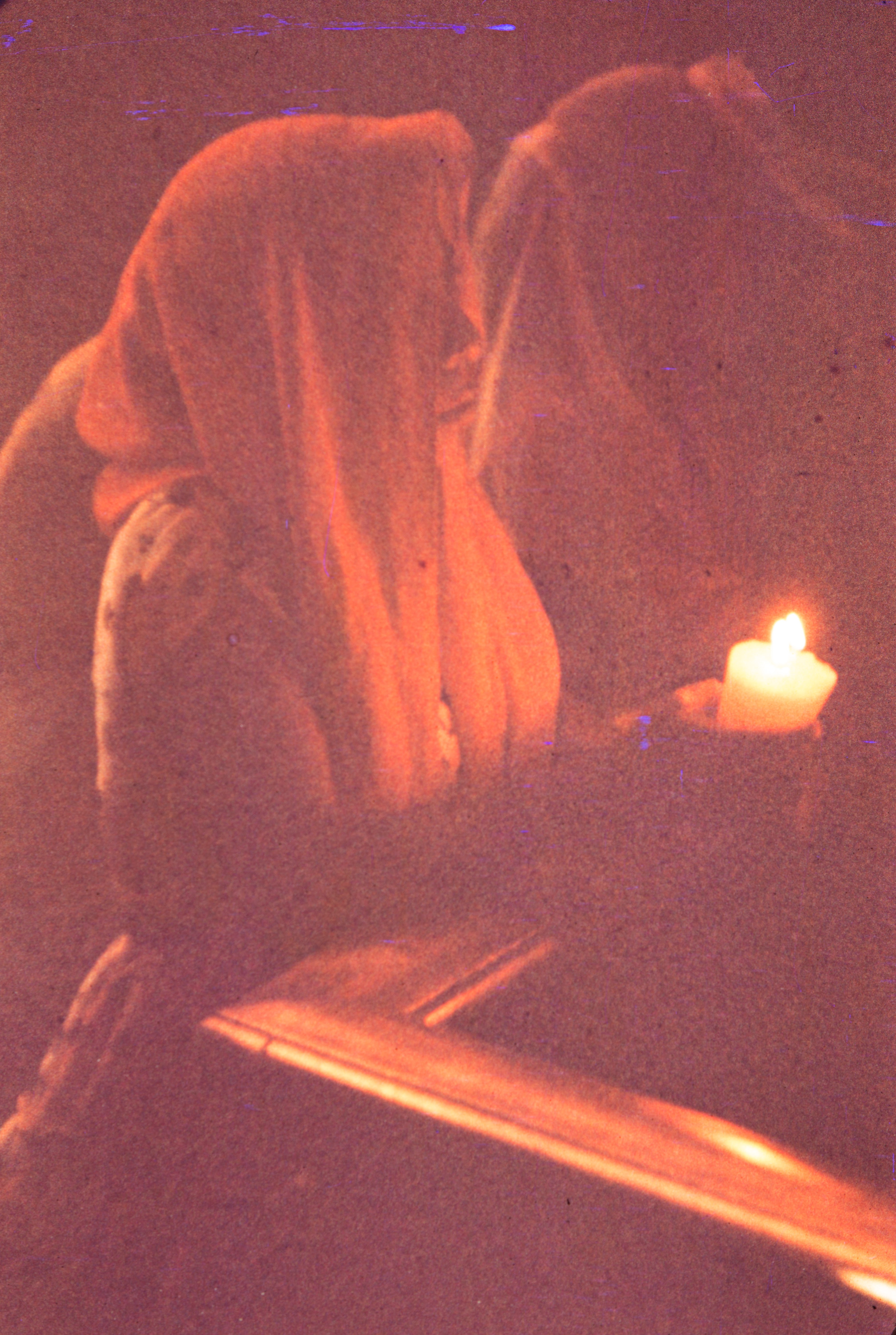 Praying with candle, Mexico, 1957