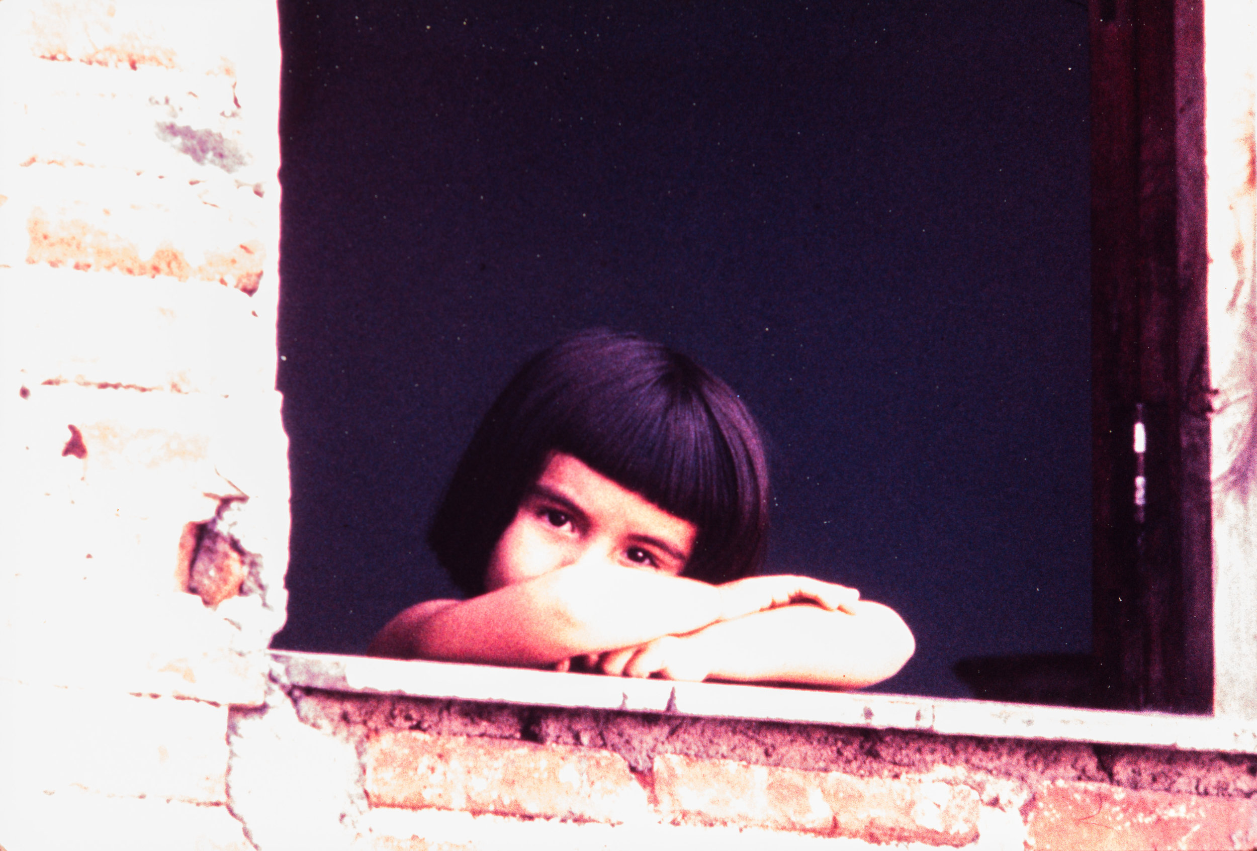 Young girl in window, Mexico, 1957