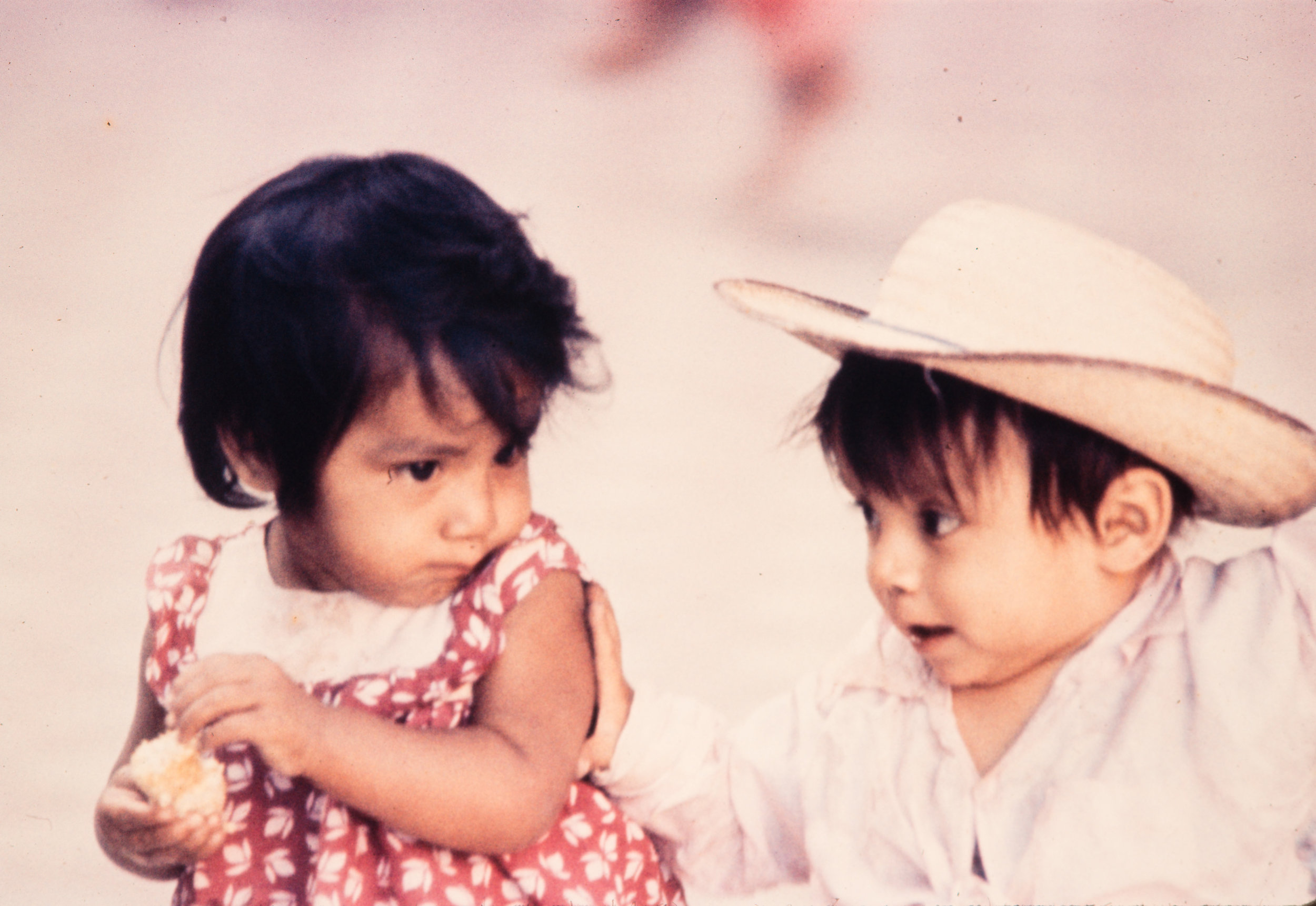 Little girl and little boy with straw hat, Mexico, 1957