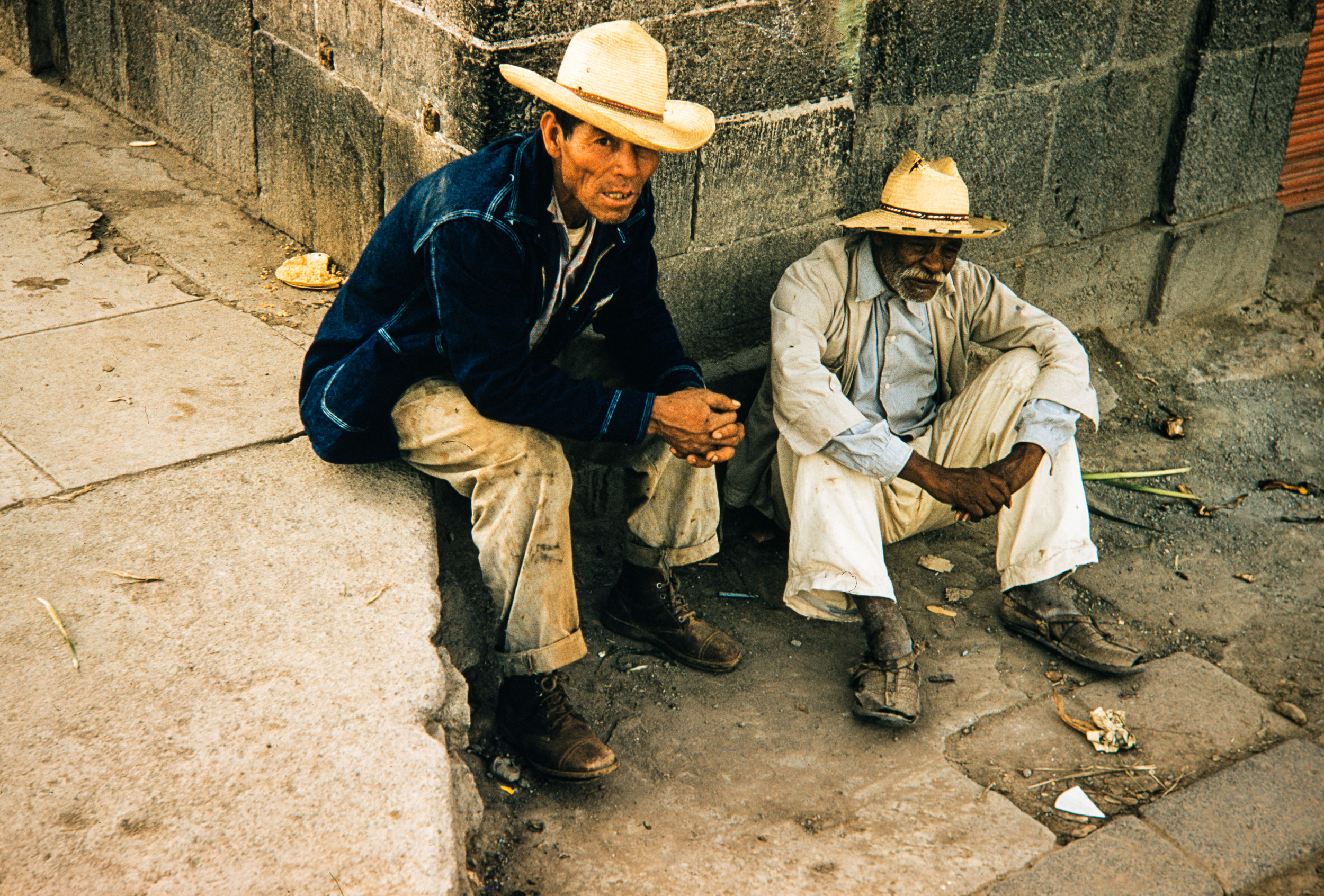 Two men sitting on street, Mexico, 1957