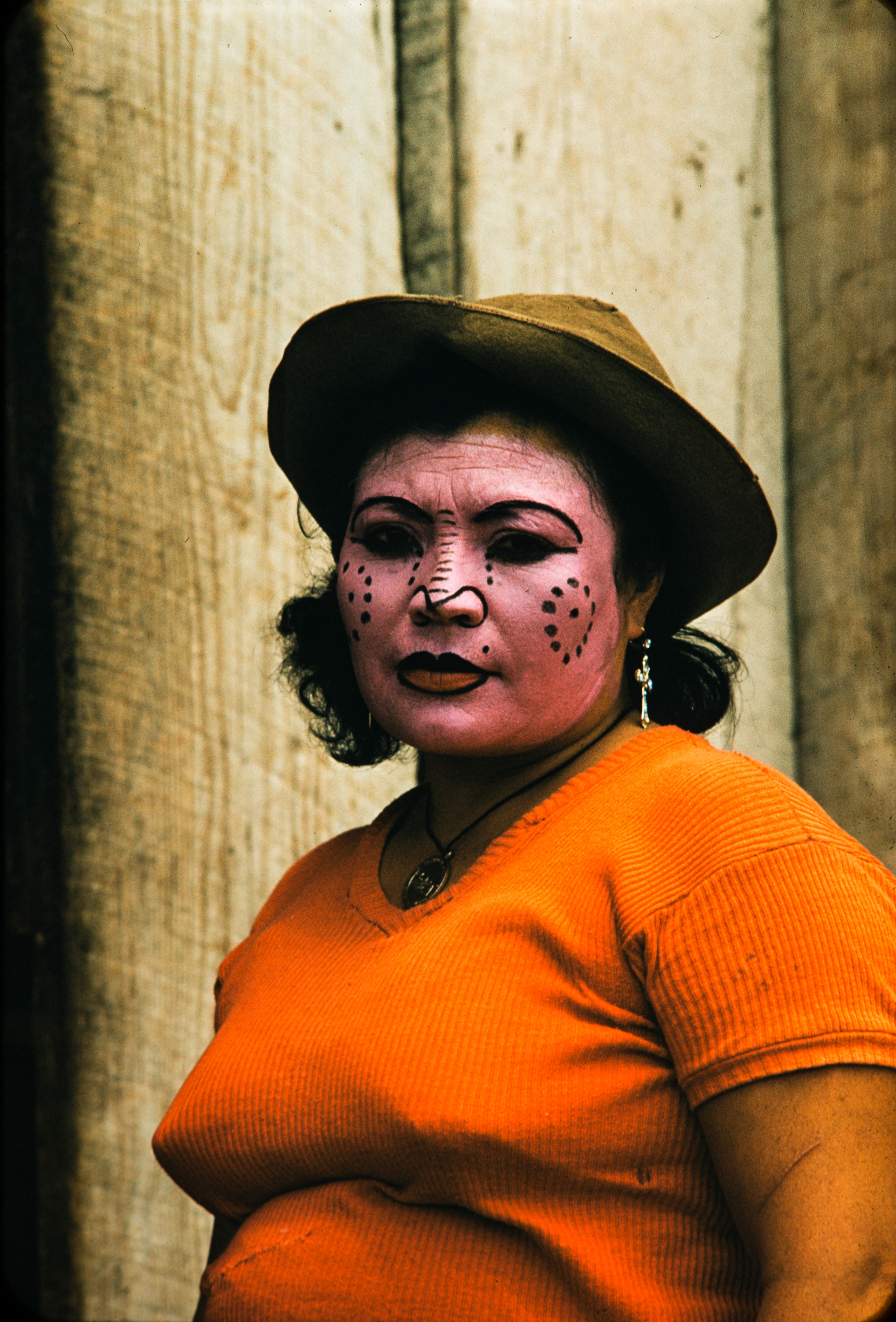 Woman in orange with face paint, Mexico, 1957