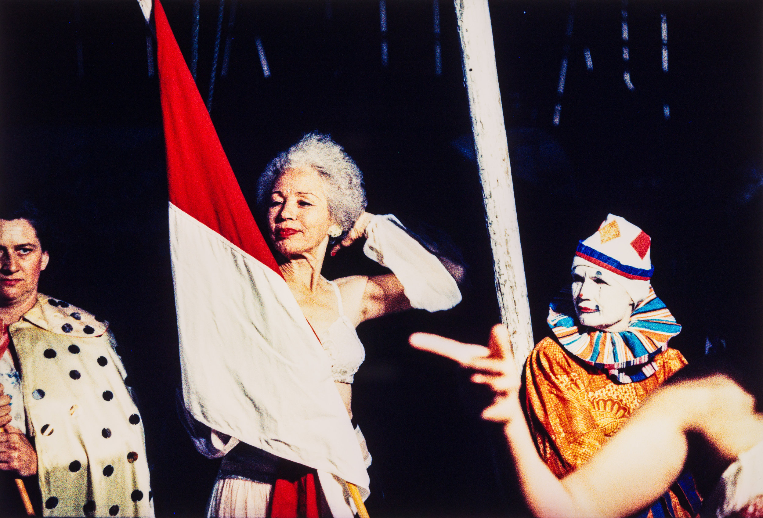 Woman with flag and clown, NYC, 1959