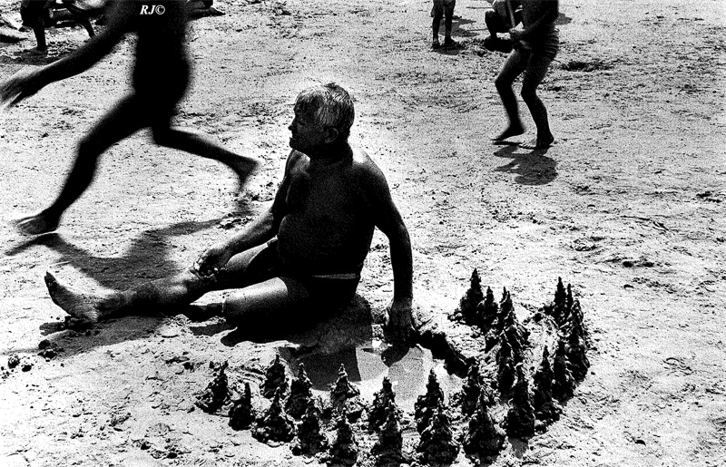 Man with sandcastles, Coney Island, 1952