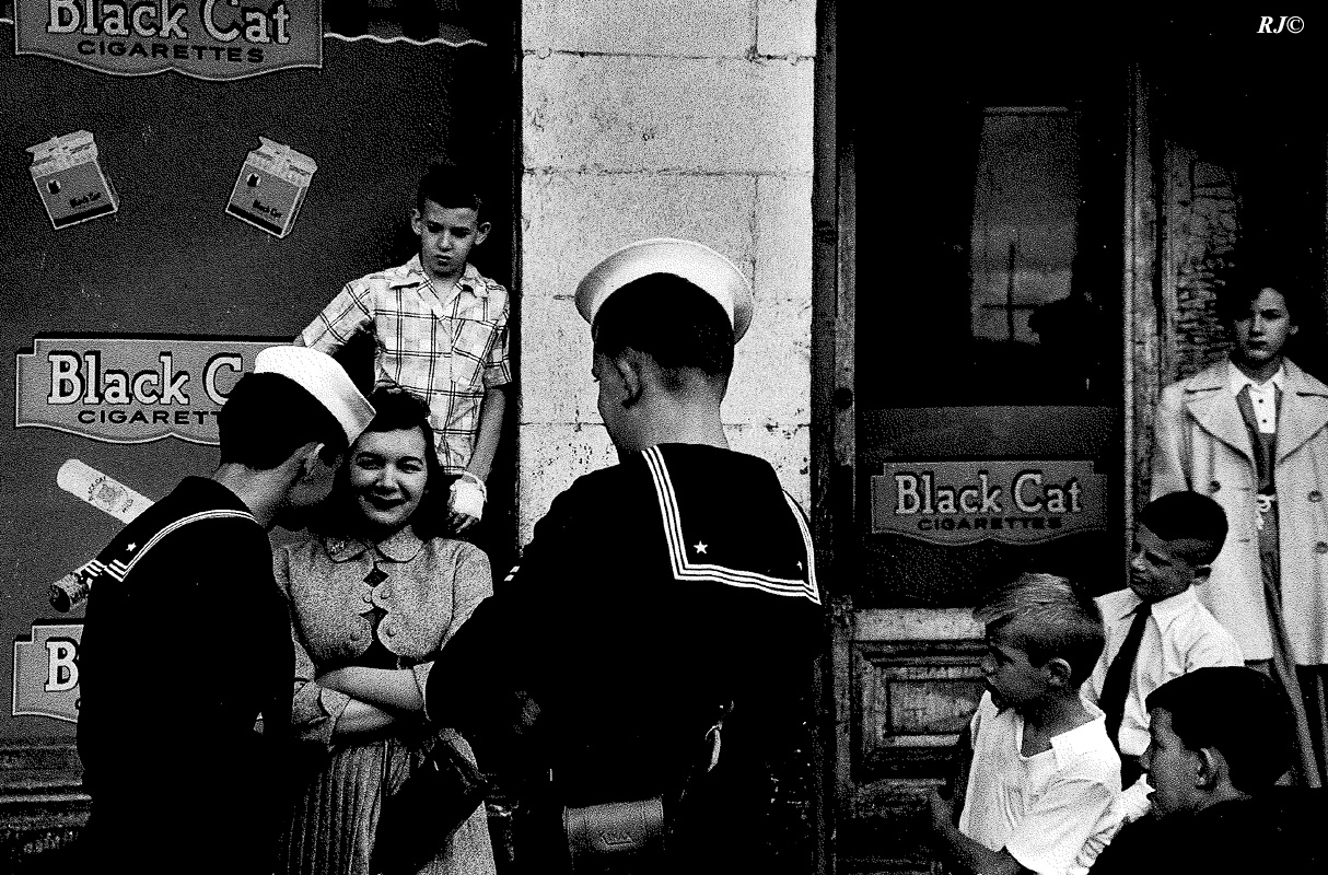 Two sailors flirting with girl, Coney Island, 1952