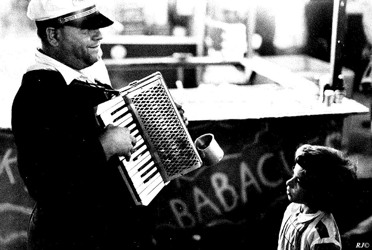 Man playing accordion, Coney Island, 1952