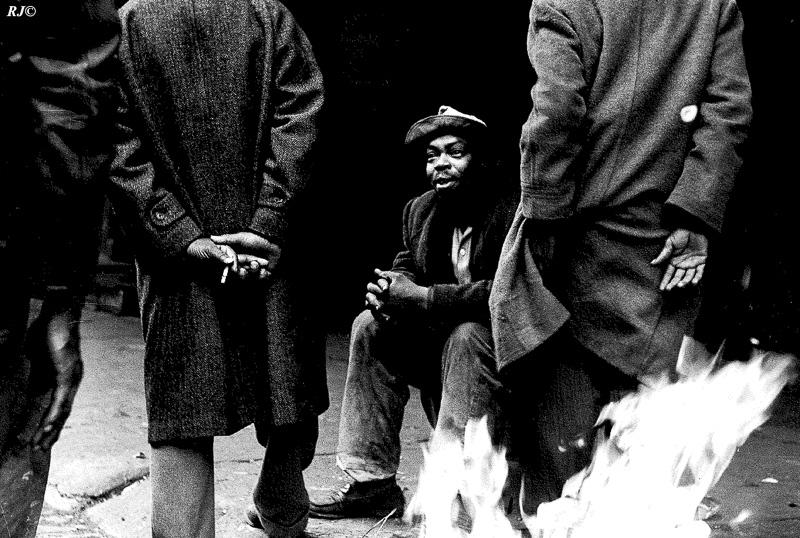Getting warm by street fire, Harlem, 1952