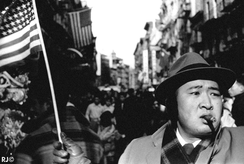 Man with flag, Chinese New Year, 1953