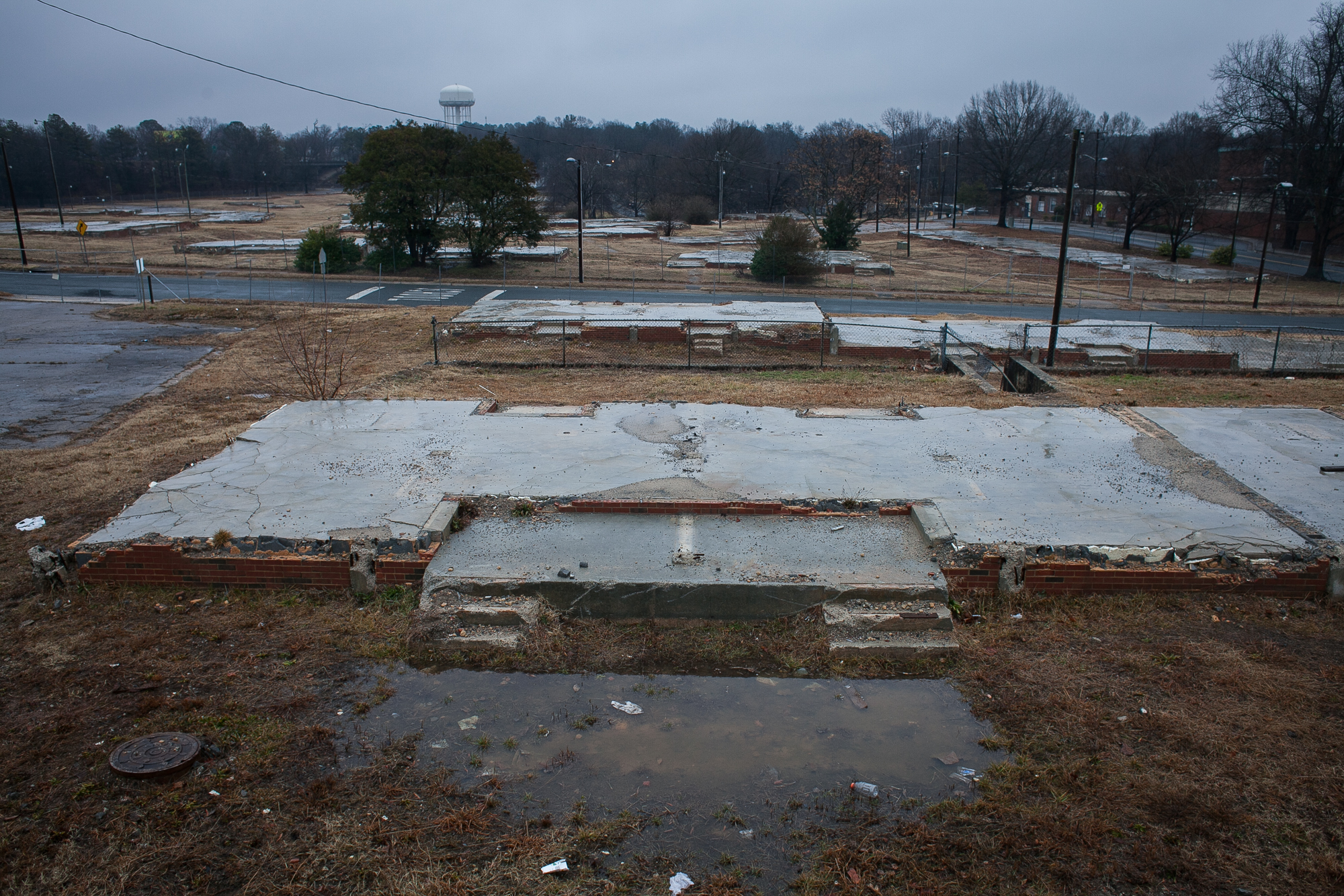 The remains of Fayette Place public housing project on Fayetteville Street in 2011. The 20-acre property, which used to be home to low-income families, has been vacant since 2007. The property was purchased by a developer that planned to turn it into affordable housing for N.C. Central University students. But by 2015, nothing has been done with the property where 200 apartments once stood. There is an acute affordable housing shortage in Durham County, and fewer low-income, working-class families can find a home. There are 8,358 total subsidized units in the county, but only 111 available according to Durham County Open Data from February, 2015.