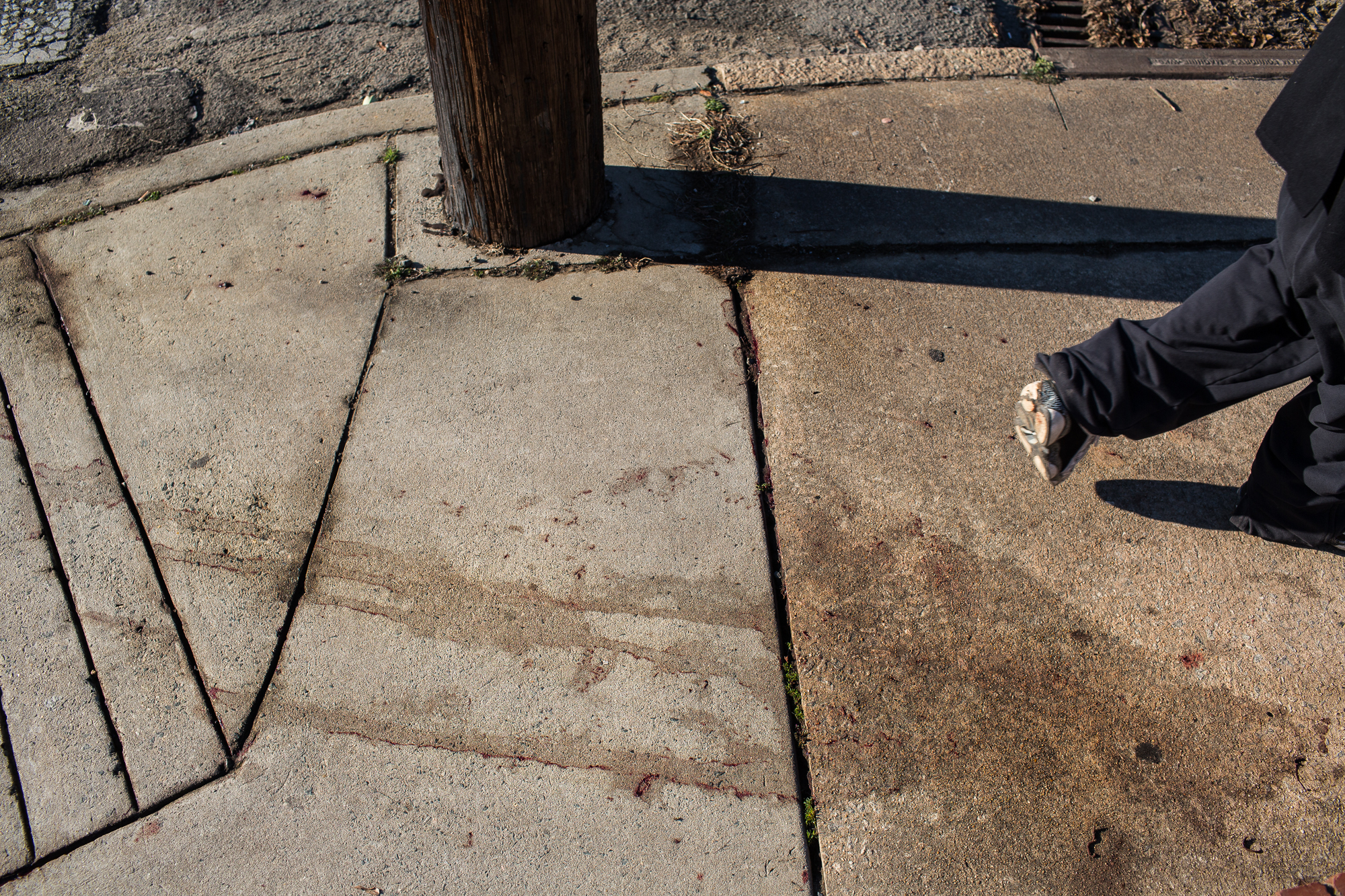 Blood stains remain hours after a bystander was killed by a stray bullet in East Durham.