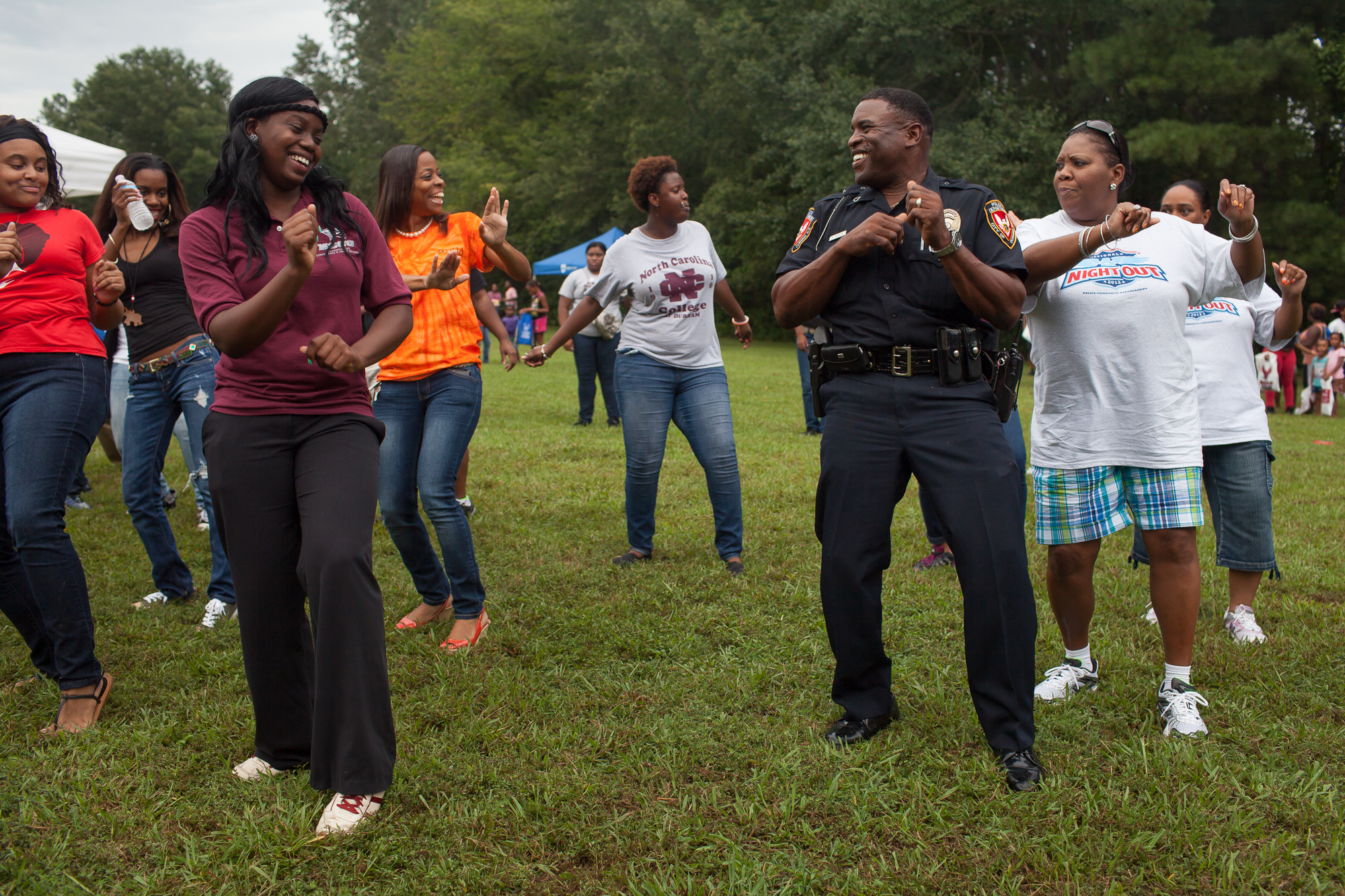 Durham Police officer R. Carson dances with members of North Carolina Central University's step dance team during National Night Out near McDougald Terrace, a low-income public housing project where shootings have been frequent. National Night Out events strengthen relationships between neighborhoods, civic groups, and police in an effort to fight crime and increase community spirit. Only about 42 percent of Durham Police officers live in Durham, according to a 2014 city report. The late Harvard University criminal justice scholar William Stuntz saw a cure to violent crime through a return to neighborhood-friendly policing over modern proactive, militaristic methods. Encouraging officers to live in or near the neighborhoods they patrol builds trust, discourages crime, and makes witnesses feel safer to talk when violence occurs. The results are more effective jury trials, fewer plea deals, more respect for the police, and more democratic justice in communities that struggle with poverty and violence.