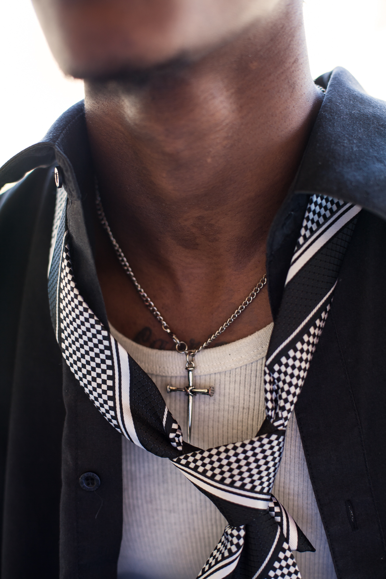 Rashard Johnson's crucifix after a job fair for felons. In his lowest moments, Rashard finds refuge in his faith.