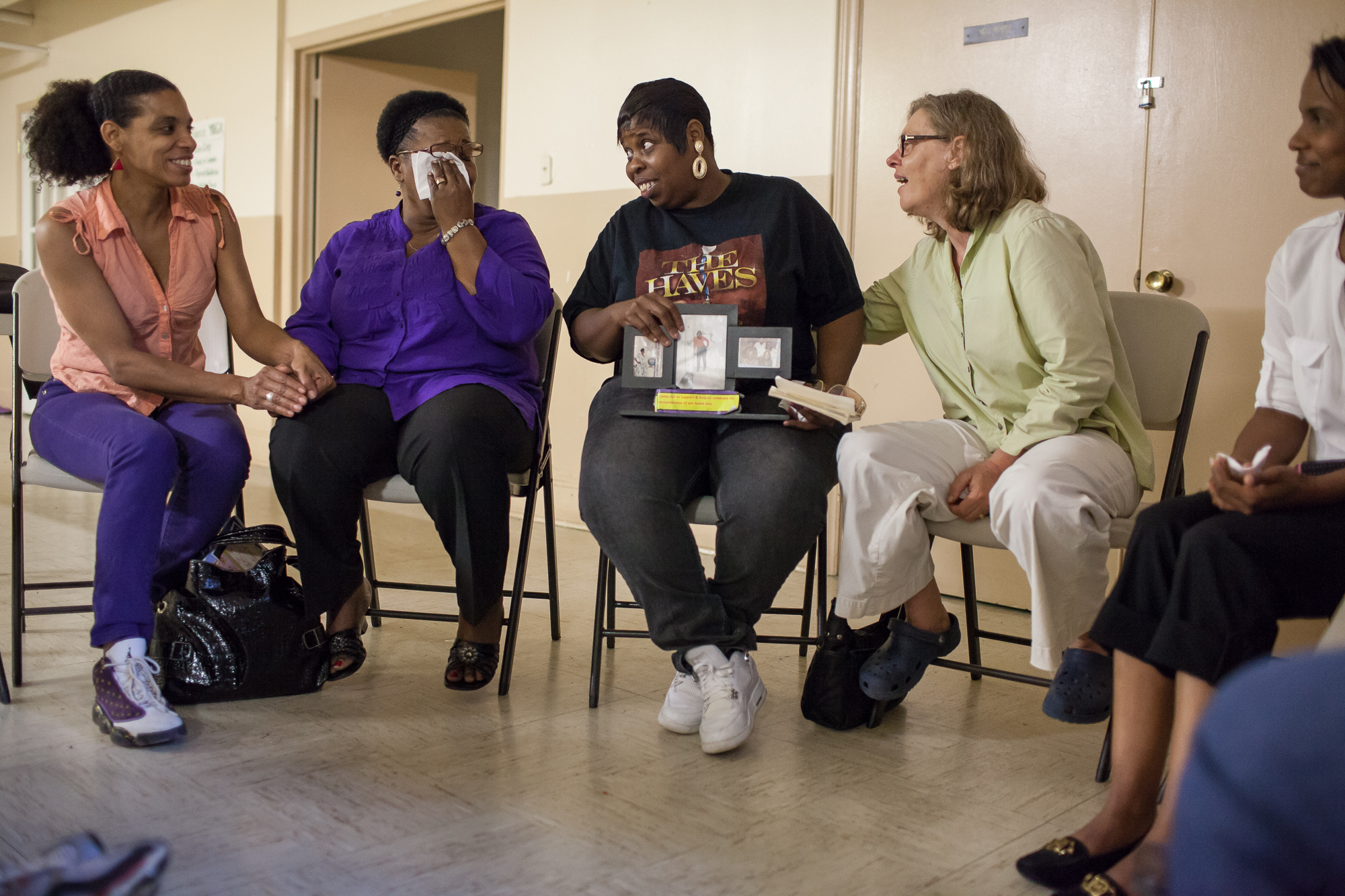 Community is formed from grief as mothers laugh and weep when they remember their murdered sons and daughters during a meeting of the Circle of Hope and Healing. The meetings are held for grieving parents by The Religious Coalition for a Nonviolent Durham in the basement of The Shepherd's House United Methodist Church in East Durham.