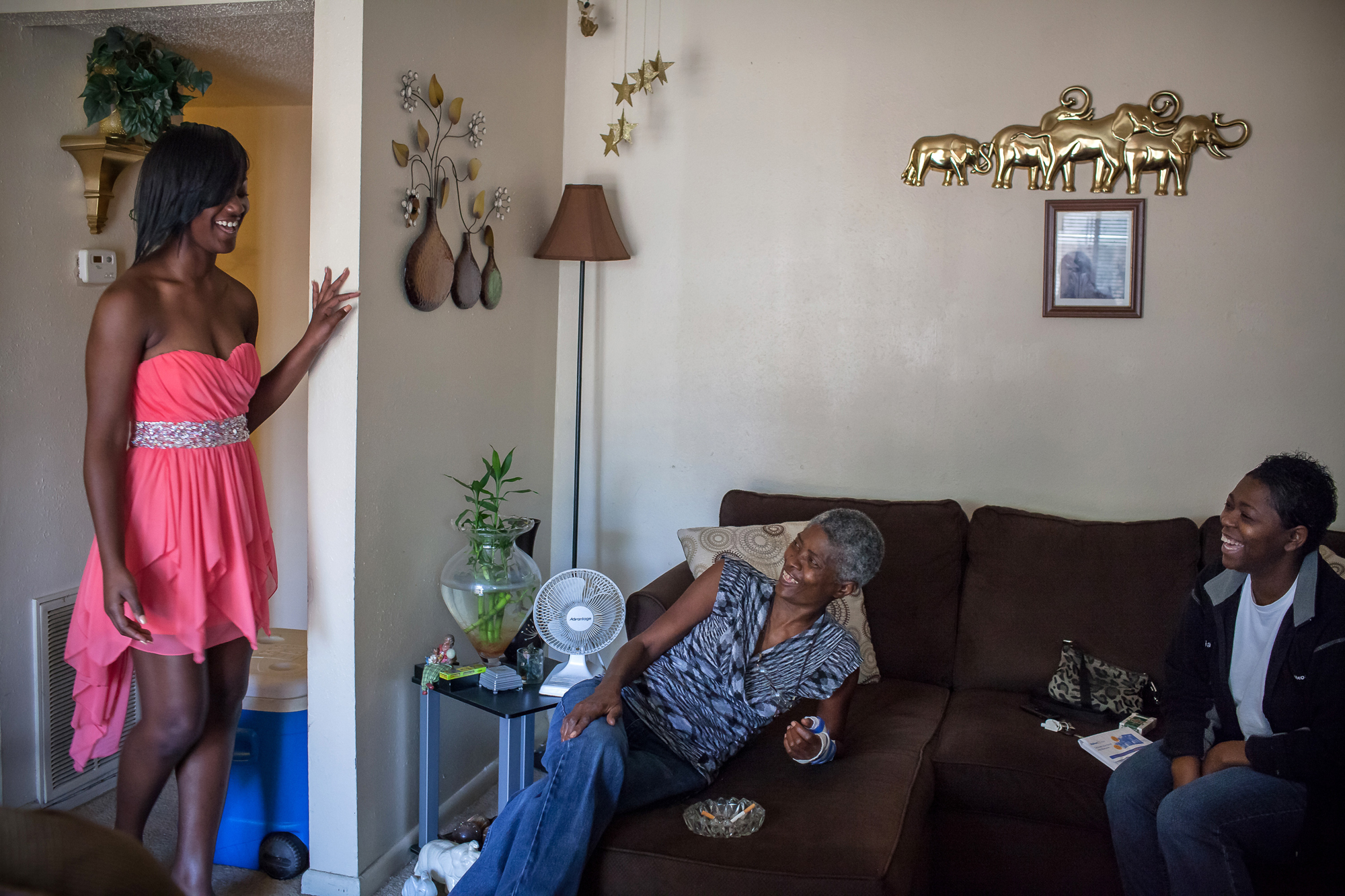 Raven Simms, Ray's daughter, shows off her prom dress to her grandmother, Joslin, and her mother, Sheila, in 2013. Raven and her siblings miss Ray the most on holidays, birthdays, proms, graduations, and other milestones. She says her father came to her in a dream a week before her senior prom. He held her tightly, whispered to her that he loved her and that everything was going to be all right. Then he vanished back to his grave.