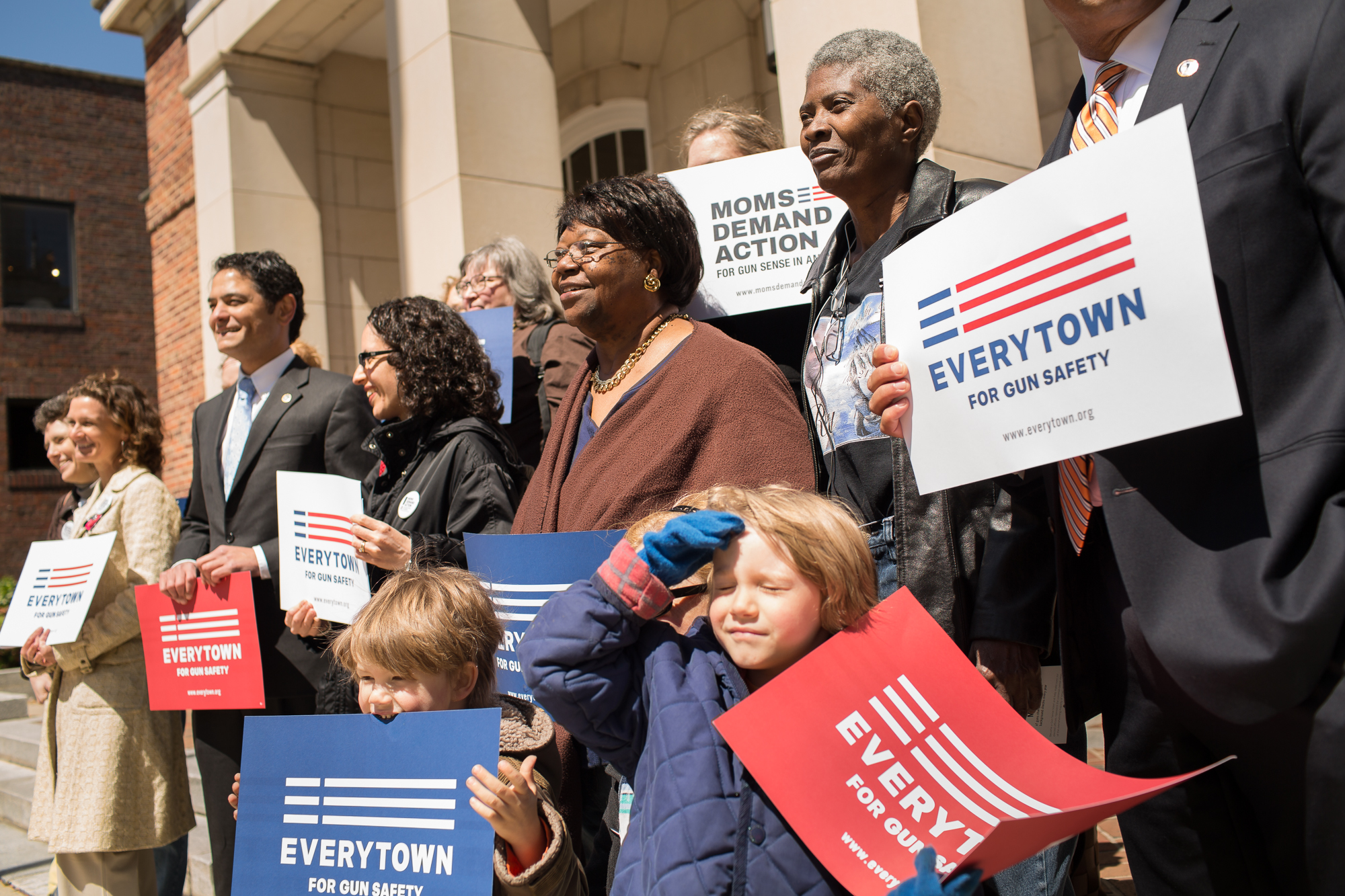 Joslin Simms poses with politicians and gun-control advocates after speaking at a Mayors Against Illegal Guns rally in Chapel Hill in 2014. Increasingly isolated by depression and grief, Joslin found companionship and community in organizations like Moms Demand Action for Gun Sense. She and other mothers who have lost their children to violence don't want them to have died in vain, so they have organized with the hope of influencing national and local gun, education and anti-poverty policies.