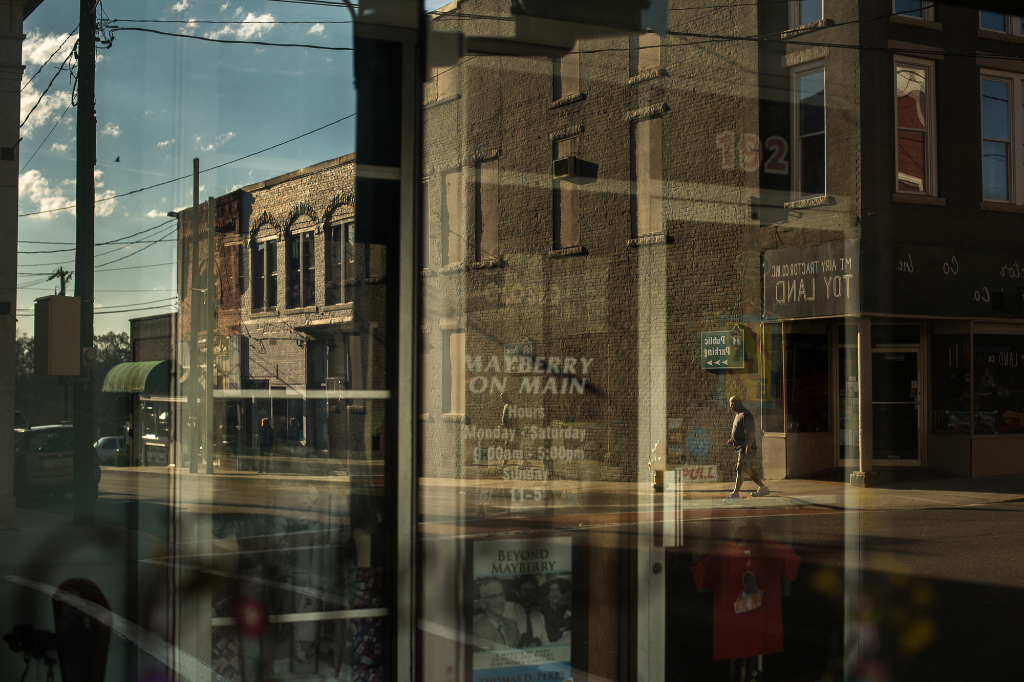 A street scene reflected in a storefront window in downtown Mount Airy, N.C., also known as Mayberry in the Andy Griffith show. Mount Airy is a cultural center in Surry County.