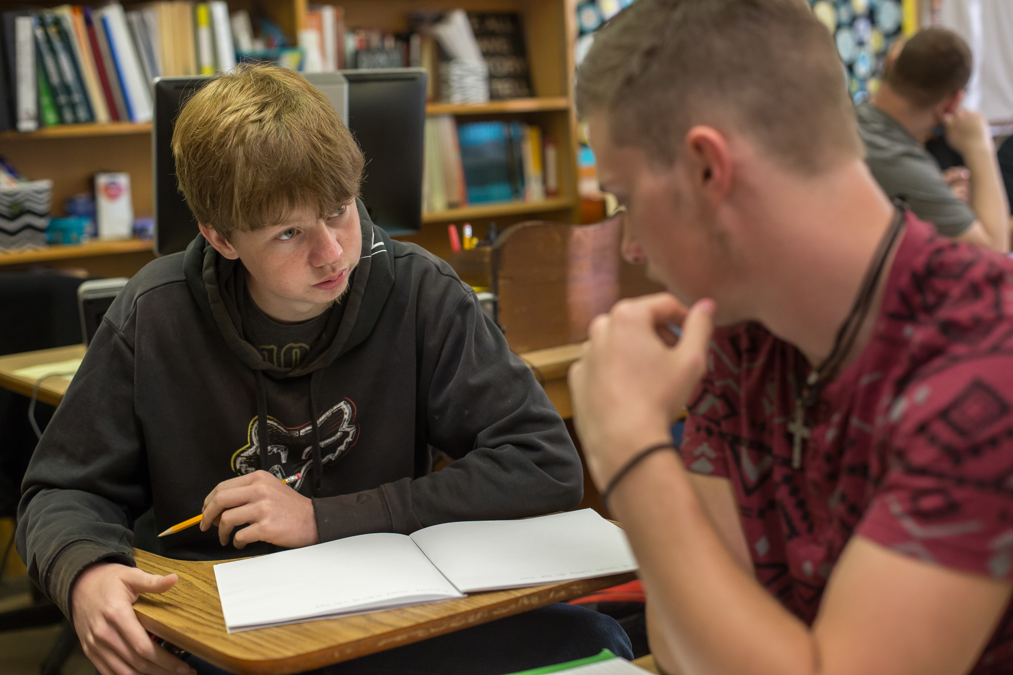 Central Surry High School seniors Timothy Hall (left) and Chris Freeman work together in an english class. Hall is dual enrolled in automotive classes at Surry Community College across the street.