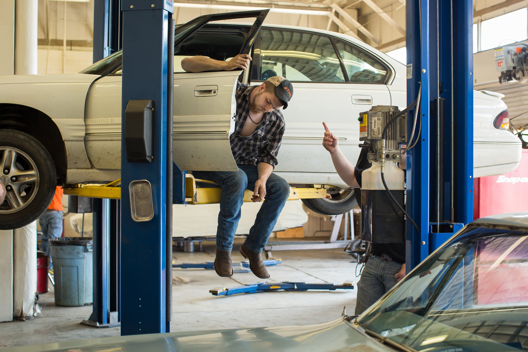 Surry Community College student Thomas Bartley relaxes between lessons in an Automotive Technology class.