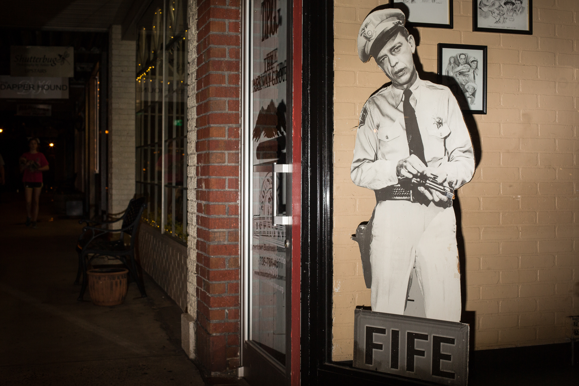 A cutout of Barney Fife of The Andy Griffith Show in a store window in Mount Airy.