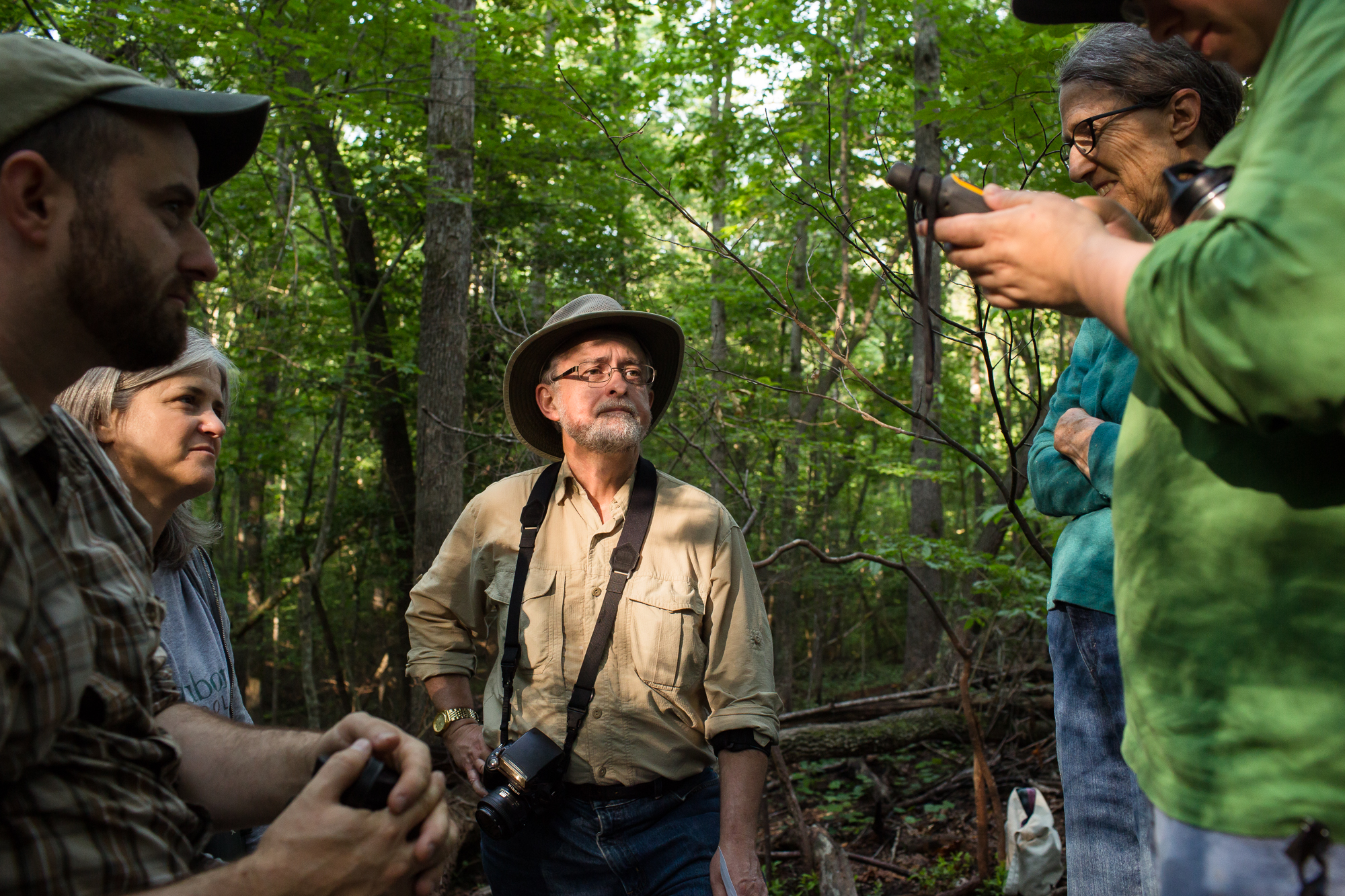 FROM LEFT: Tim Guida of the Smithsonian Migratory Bird Center, Kim Brand of the Forsyth Audubon Society and volunteers David Shuford, Jean Chamberlain and Kim Thorington during a break from capturing Wood Thrushes at Pilot Mountain in Pinnacle, N.C.