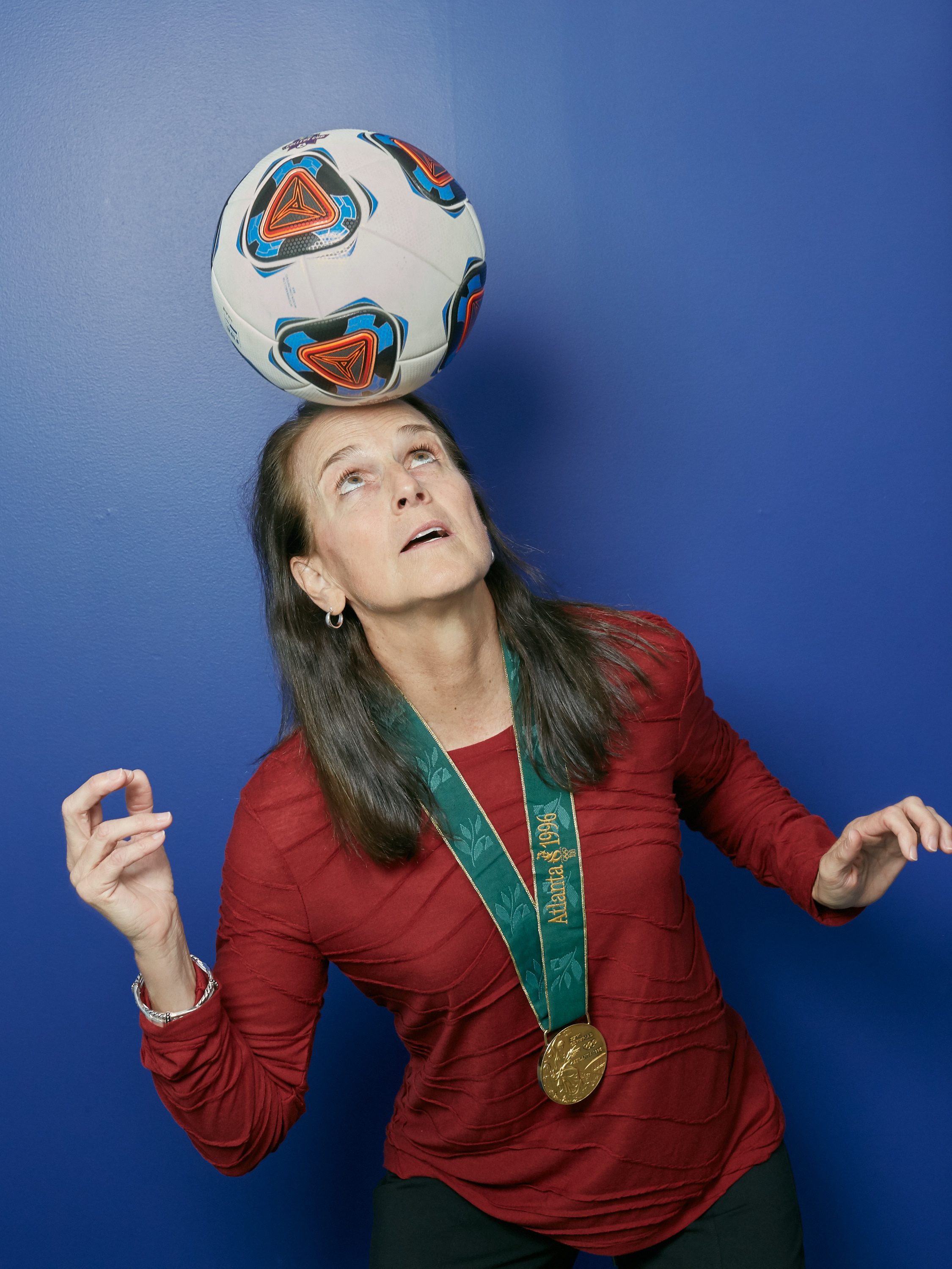 Carla Overbeck, Assistant Coach of Duke University's Women's Soccer Team, and her gold medal from the 1996 Atlanta Summer Olympic Games. For Duke University.