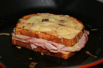 CROQUE MONSIEUR ( A TOASTED CHEESE AND HAM SANDWICH)