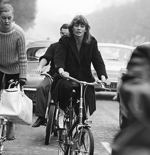 FRANCOISE HARDY RIDING A BICYCLE IN PARIS