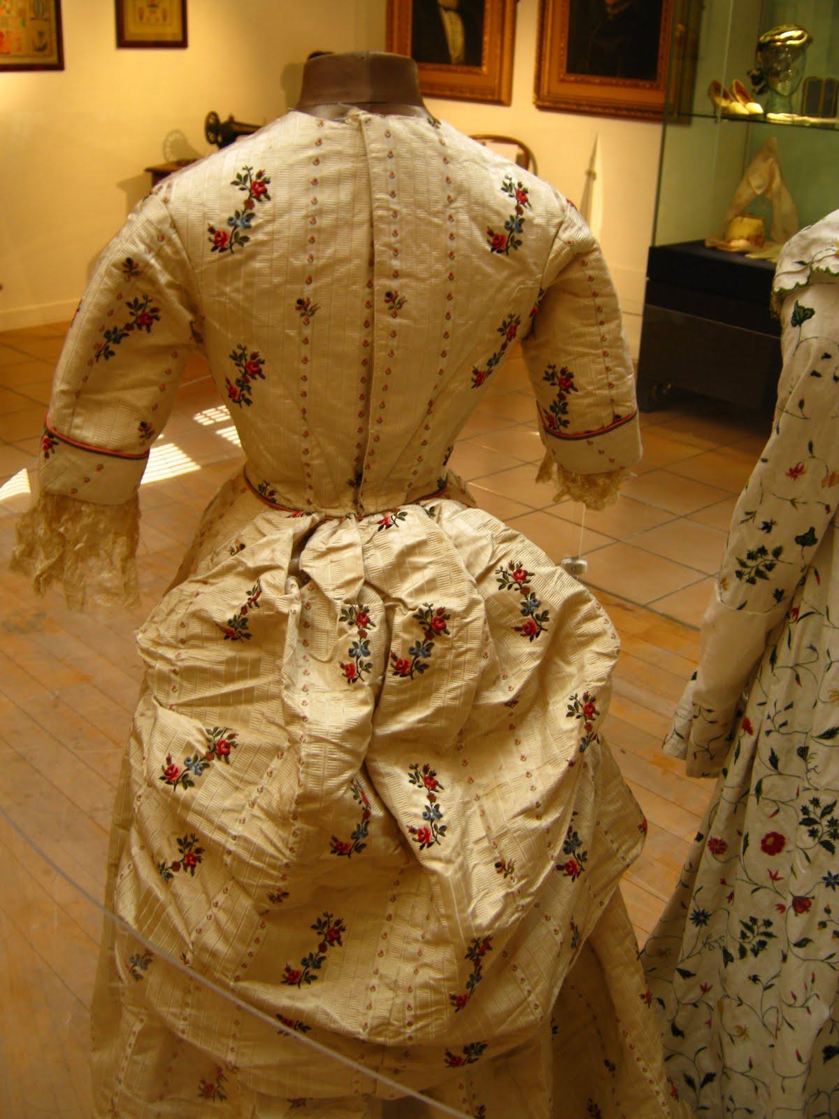 A SPITALFIELDS SILK DRESS WITH A POLONAISE BUSTLE