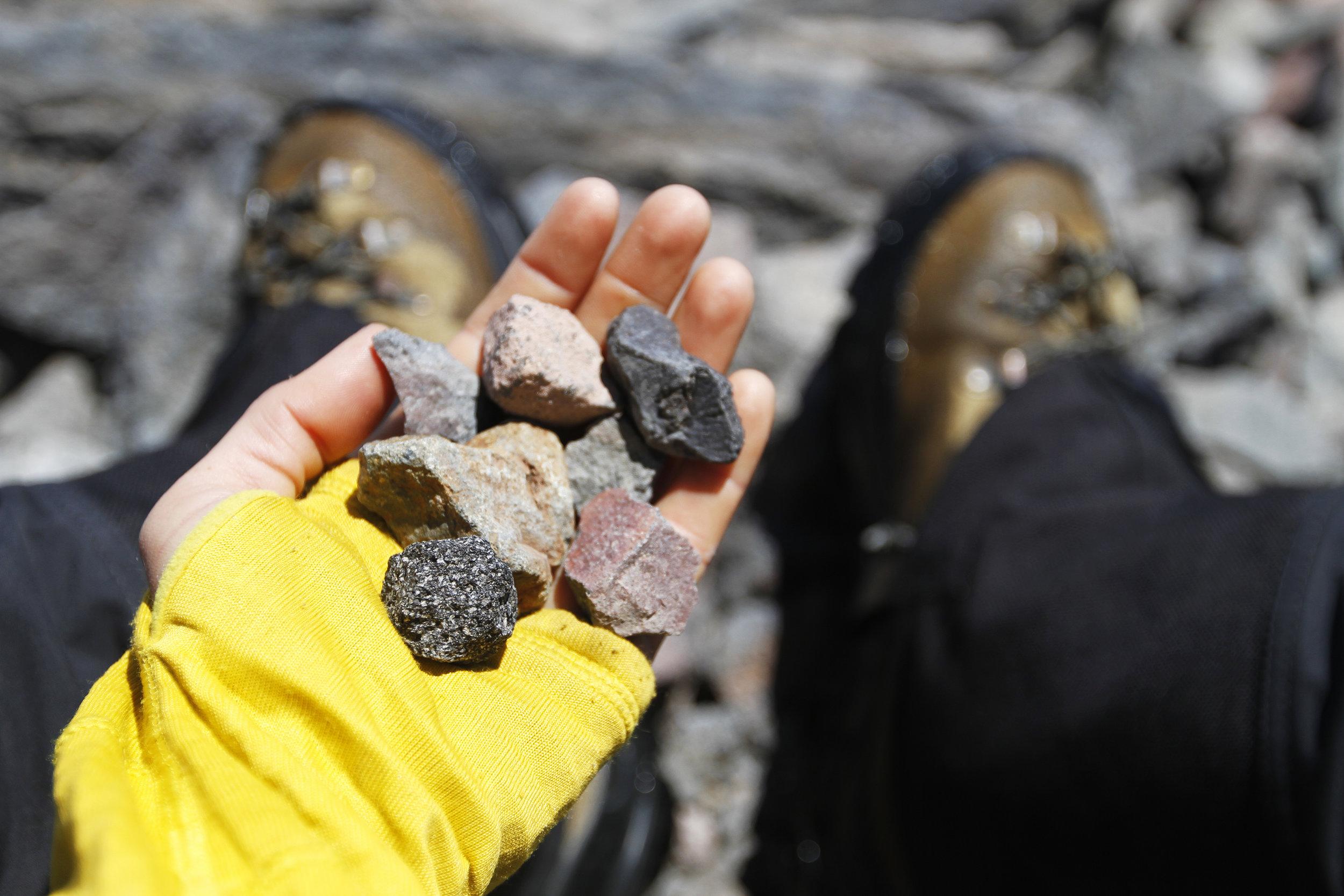 Collecting volcanic rocks while waiting on Jon.
