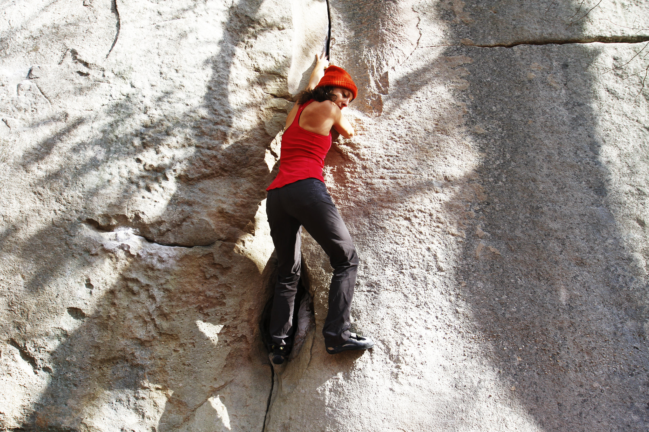Theresa D'Aquila utilizes her trad climbing skills on Crack of Doom, V5.