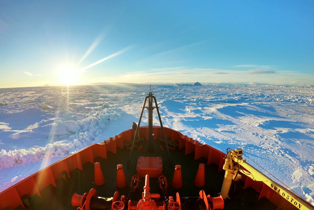 The sun sets over the bow of the Laurence M. Gould, as we make our way across the frozen Weddell Sea.