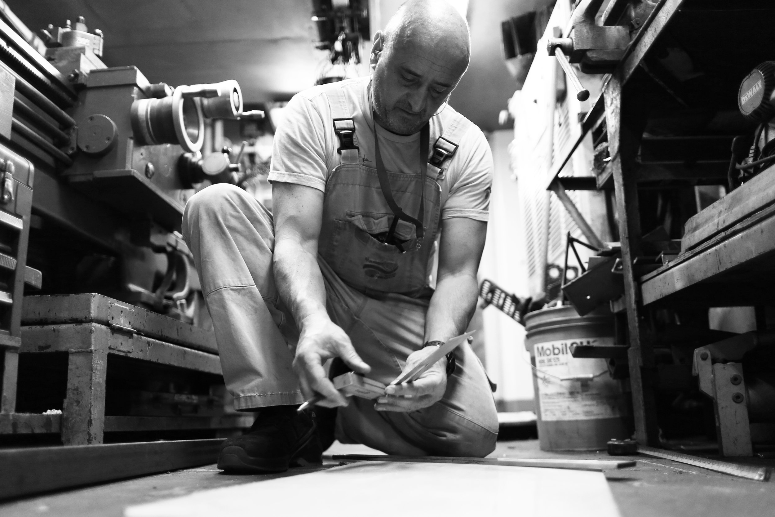 Documenting Miro hard at work on the floor of the engine room workshop.