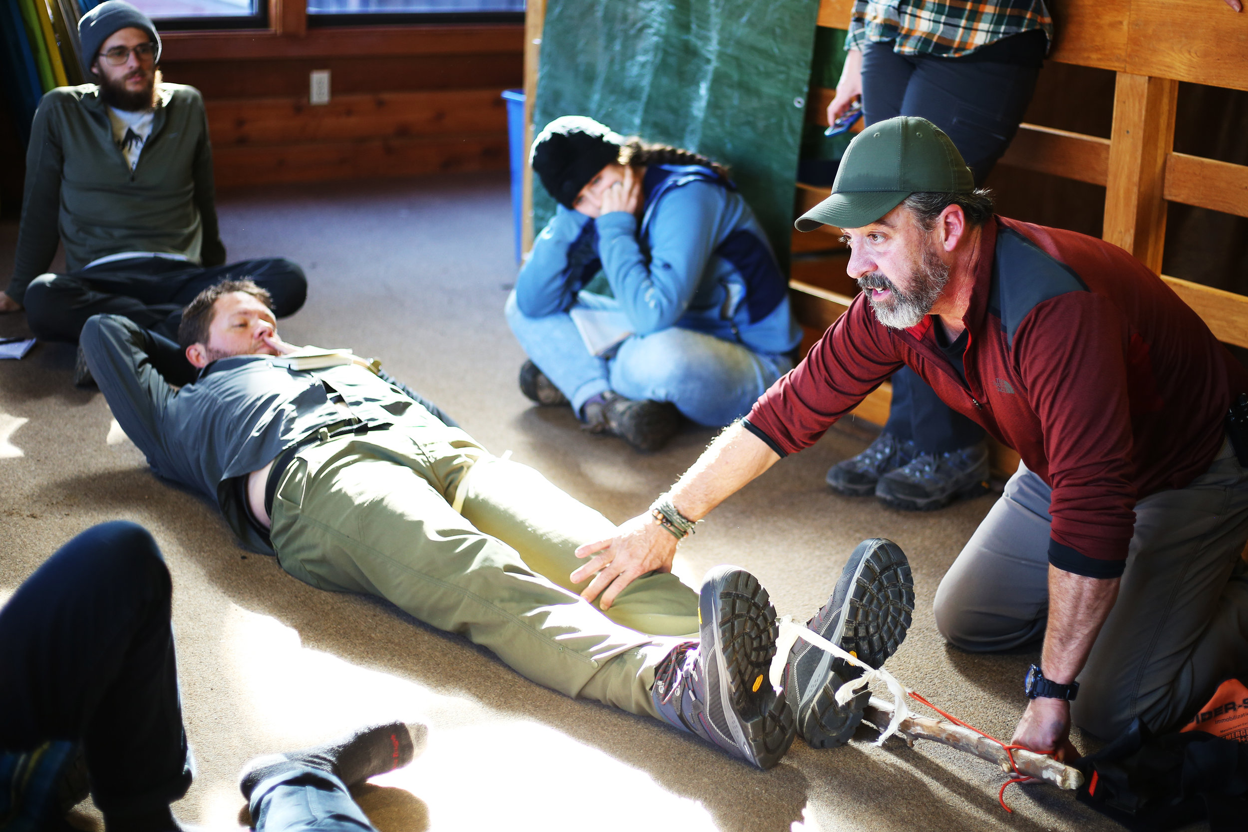 Conceptual physics meets backcountry.  With Chad acting as the patient, Randy teaches us how to set a broken femur using a long tree branch and few pieces of rope.