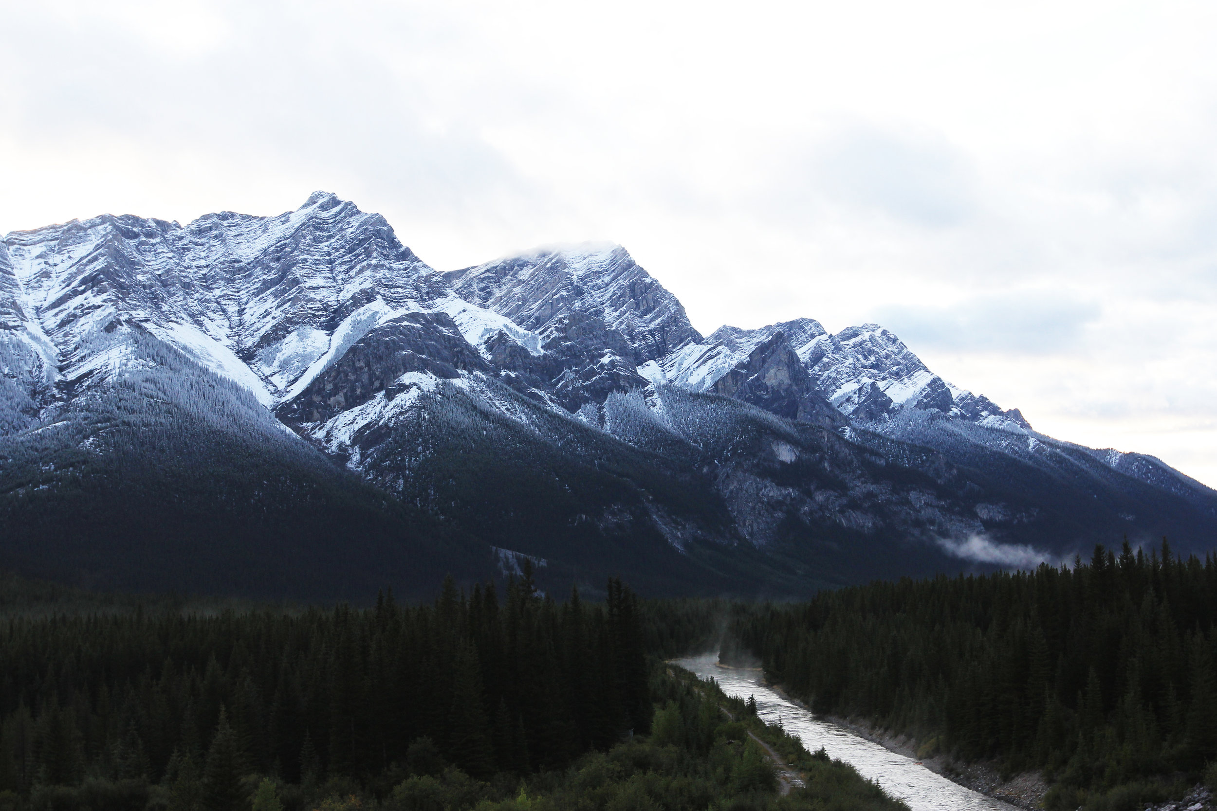 Ridge lines in Canadian Rockies (outside Canmore) appear vivid after recent snow fall | August 2015