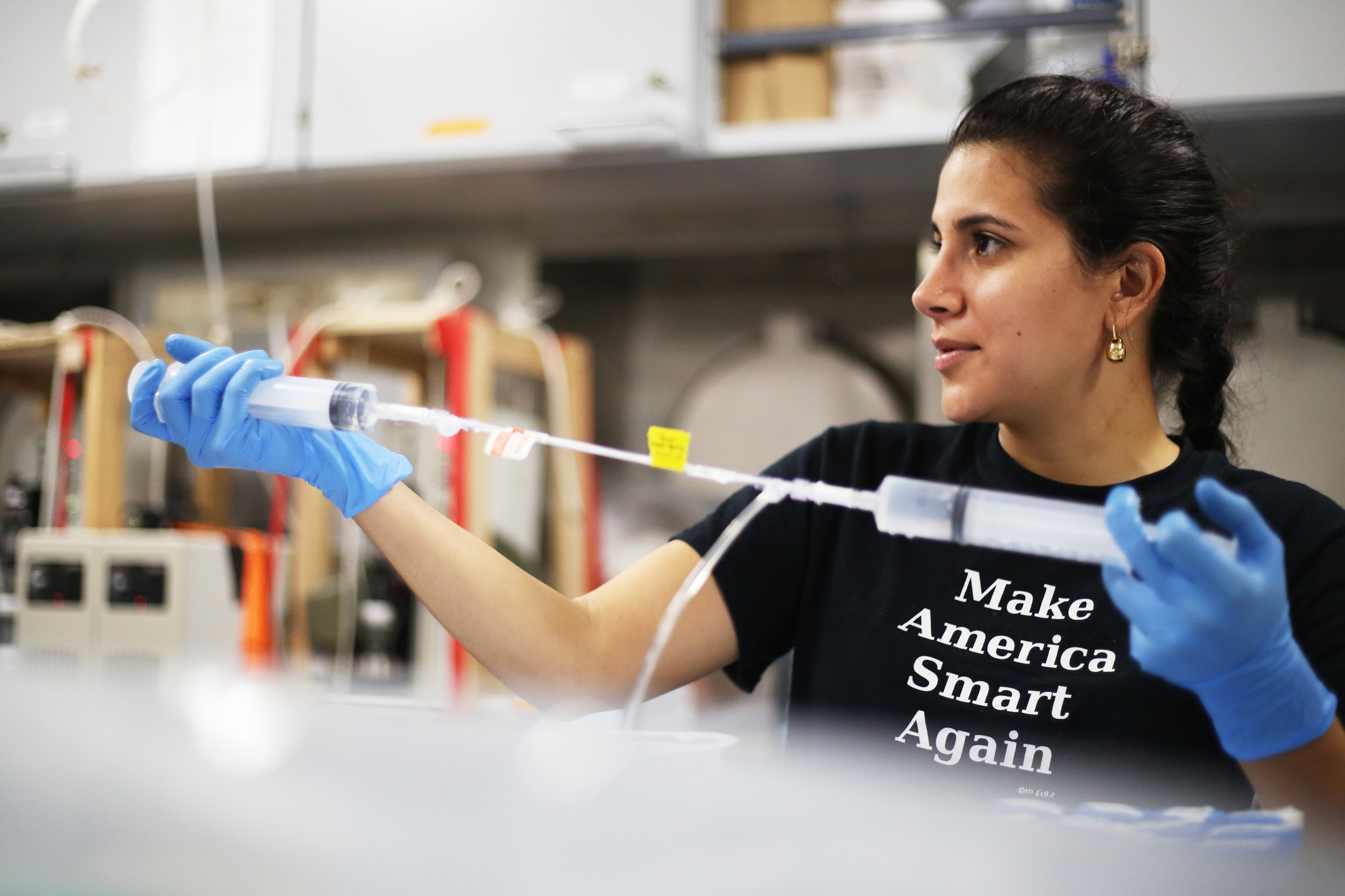 Diana Dumit, a graduate student in the Babbin Lab at MIT, works in the wet lab aboard R/V  Falkor  | July 2018